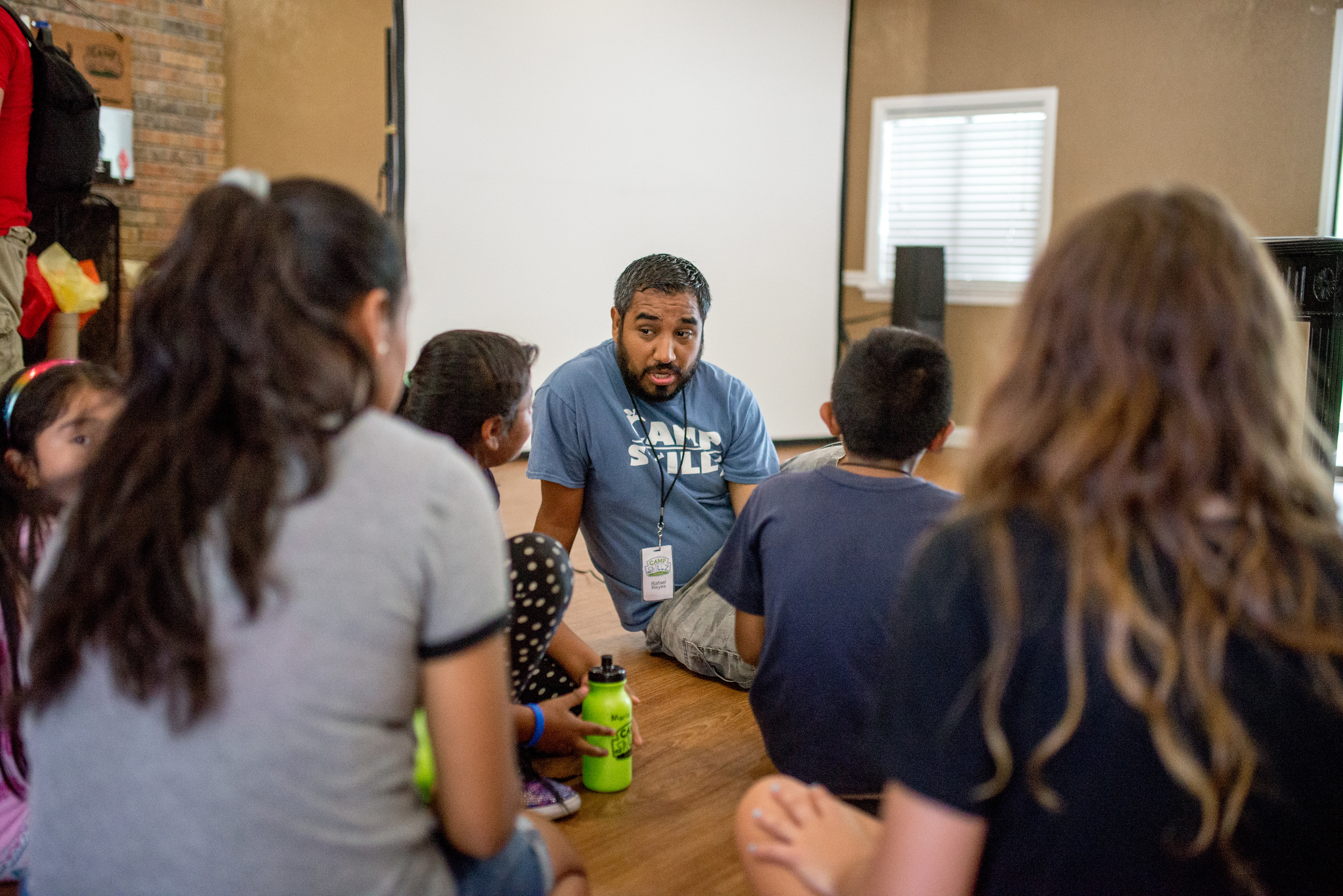 """Rafael Reyes, program leader at Camp Skillz: Antioch, as a small group chat with campers. Our staff doesn't just """"do games,"""" but facilitates an all around quality program for kids."""