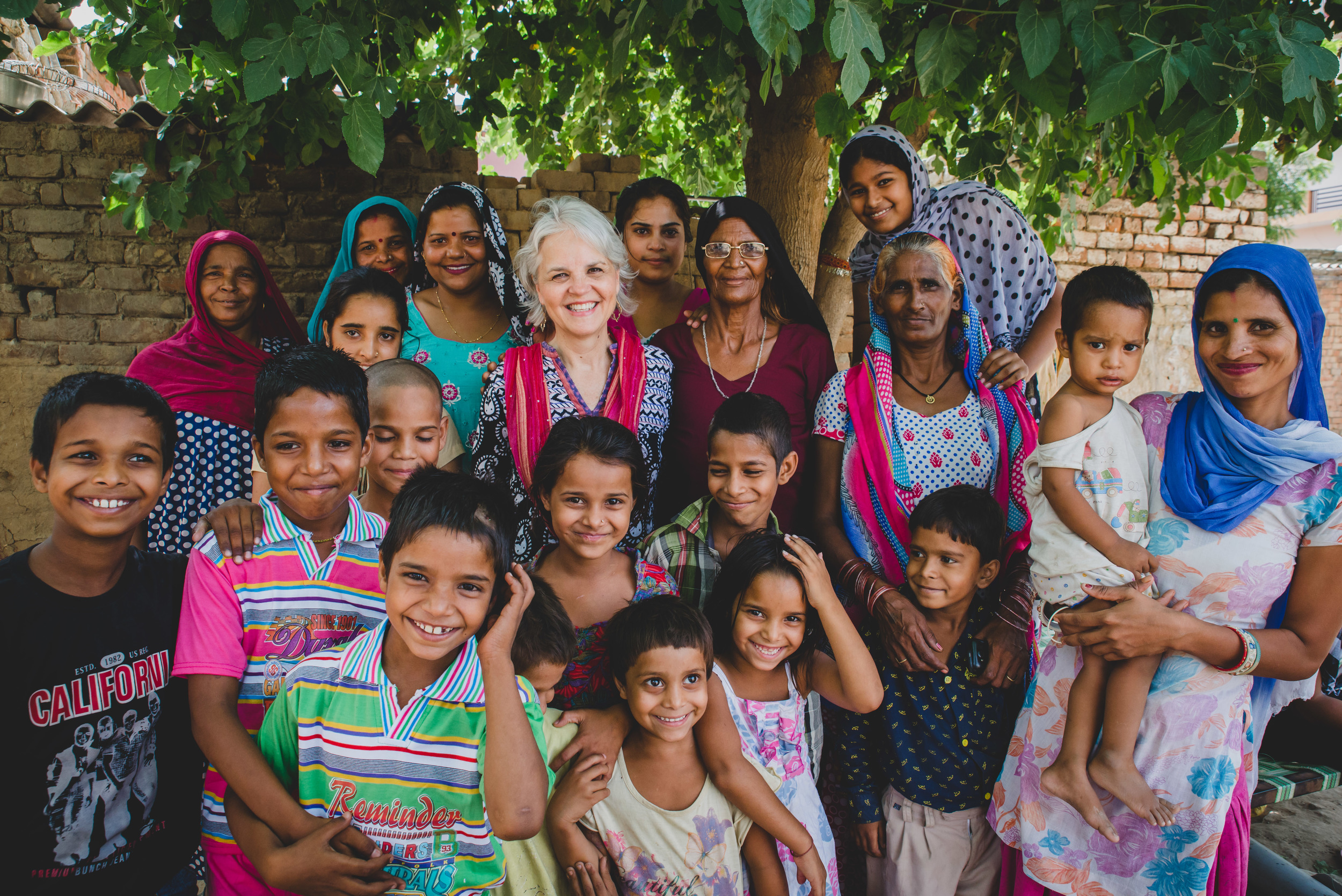 """""""How many of these children did you deliver?"""" I asked as more and more children crowded around to hear what we were talking about. A wide smile spread over her face and with pride, she answered,""""I delivered all of them."""""""