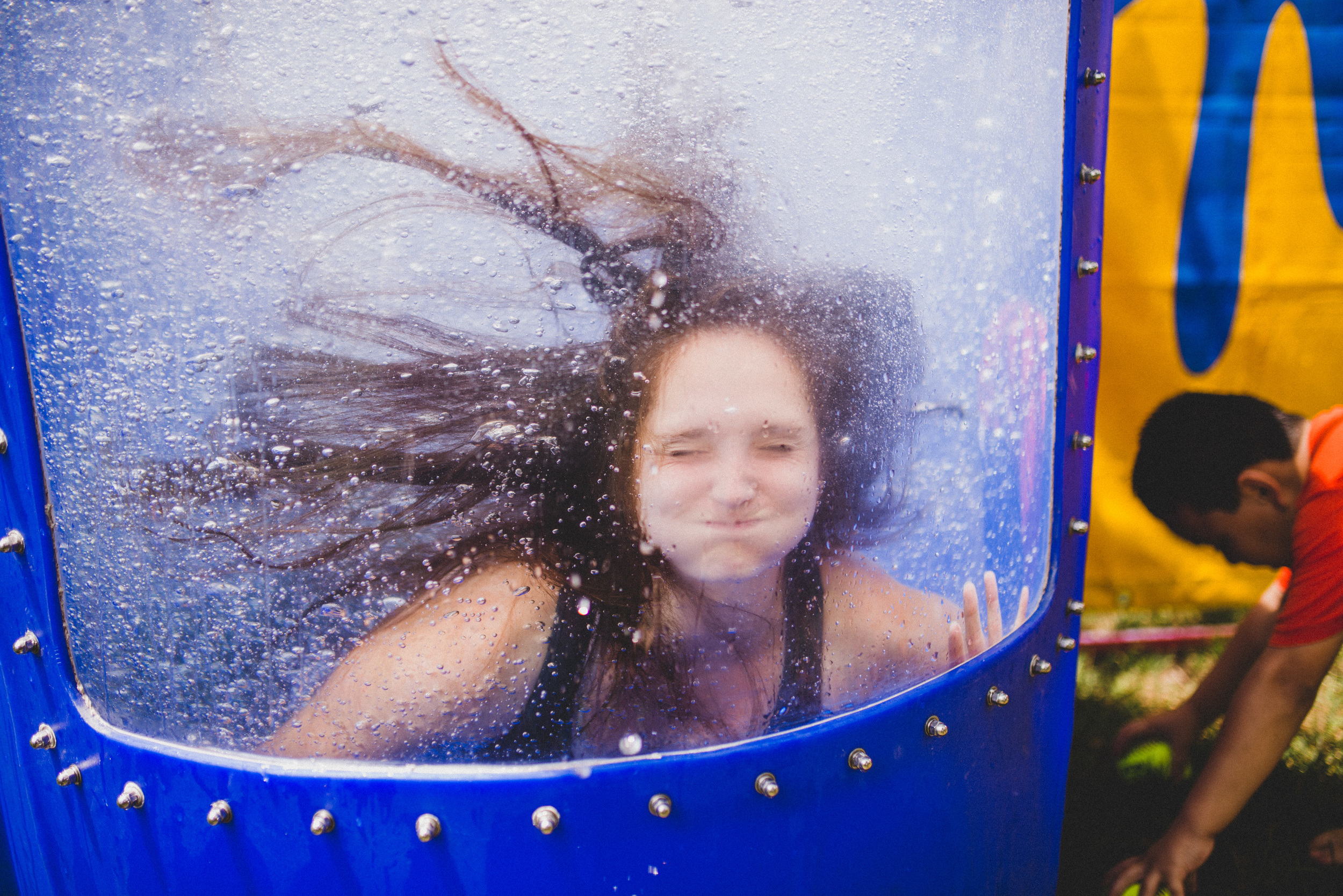 You'd be mistaken to think her joy was because of the cool water on a hot day. Coordinator Stefanie Price smiles because she knows that just outside the dunk tank, her campers are safe, feel loved, and are hysterically laughing. That is the job of a Camp Skillz coordinator, and they don't smile until that job is done.