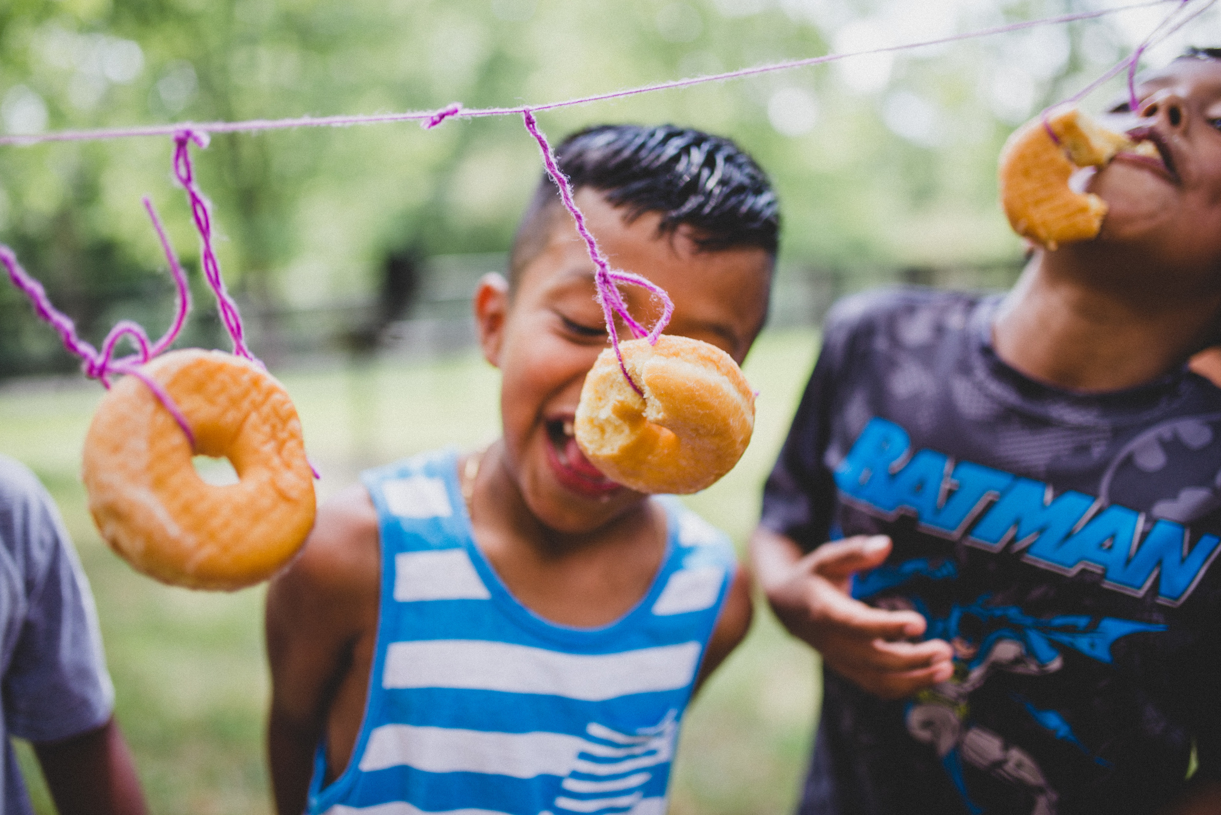 """What a silly game, but what a shared experience as well. The first thing that happens when the kids are finished is the laughter from the conversations about the experience. The donut game works as mortar for the forming relationships of the campers. The shared experience of something so silly has the components of a relational bonding agent. """"Remember when we ate those donuts from the strings at camp?!"""""""