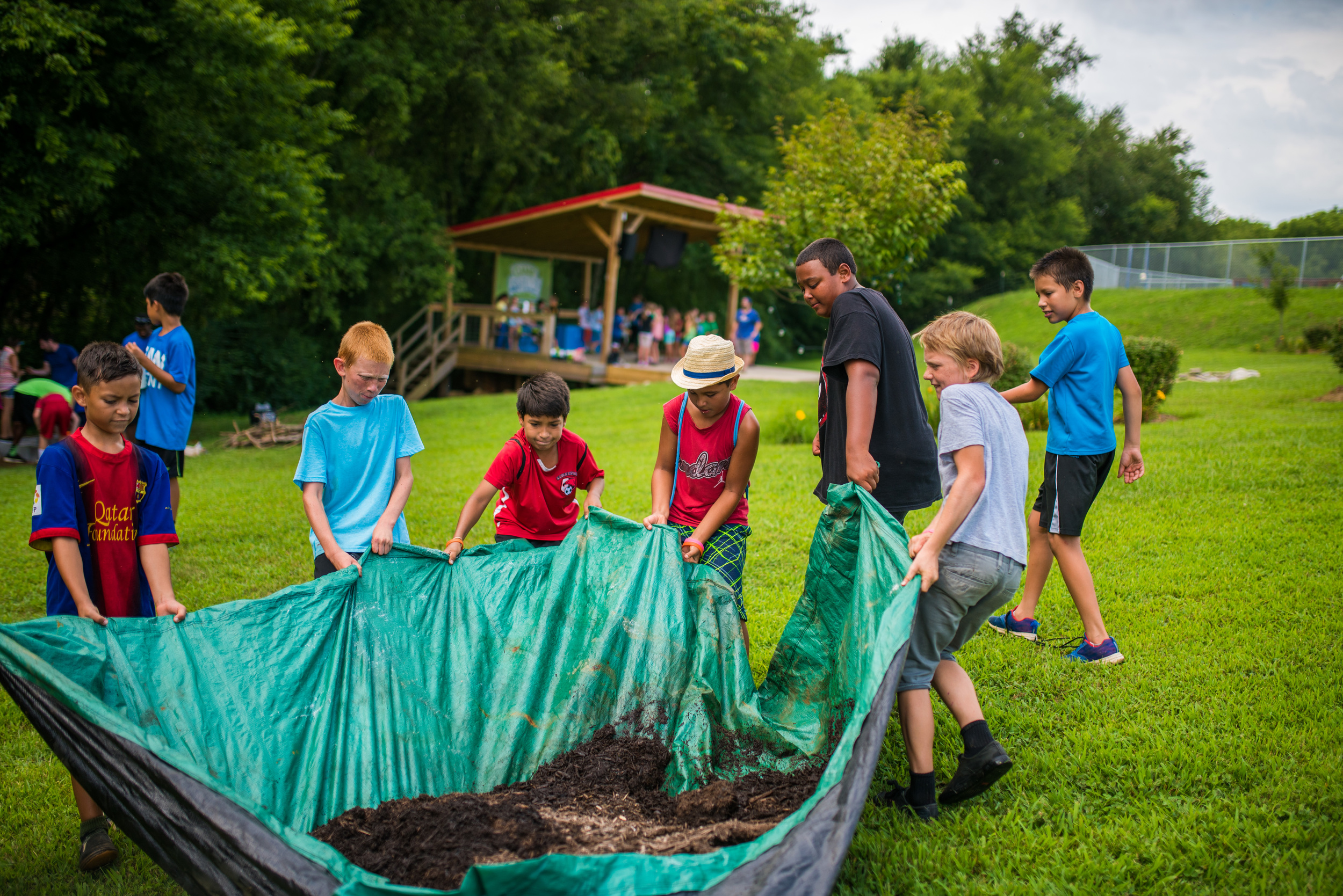The boys loved the challenge of figuring out how to move this mulch and get it dumped into a nearby brush pile. Not a single one of them is able to move this pile on their own. They need one another, and knowing that we need one another is a great lesson. Life is heavy without the strength and support of your friends, and here in these small activities they are tutored into a healthy mindset - to depend on one another is strength not weakness.