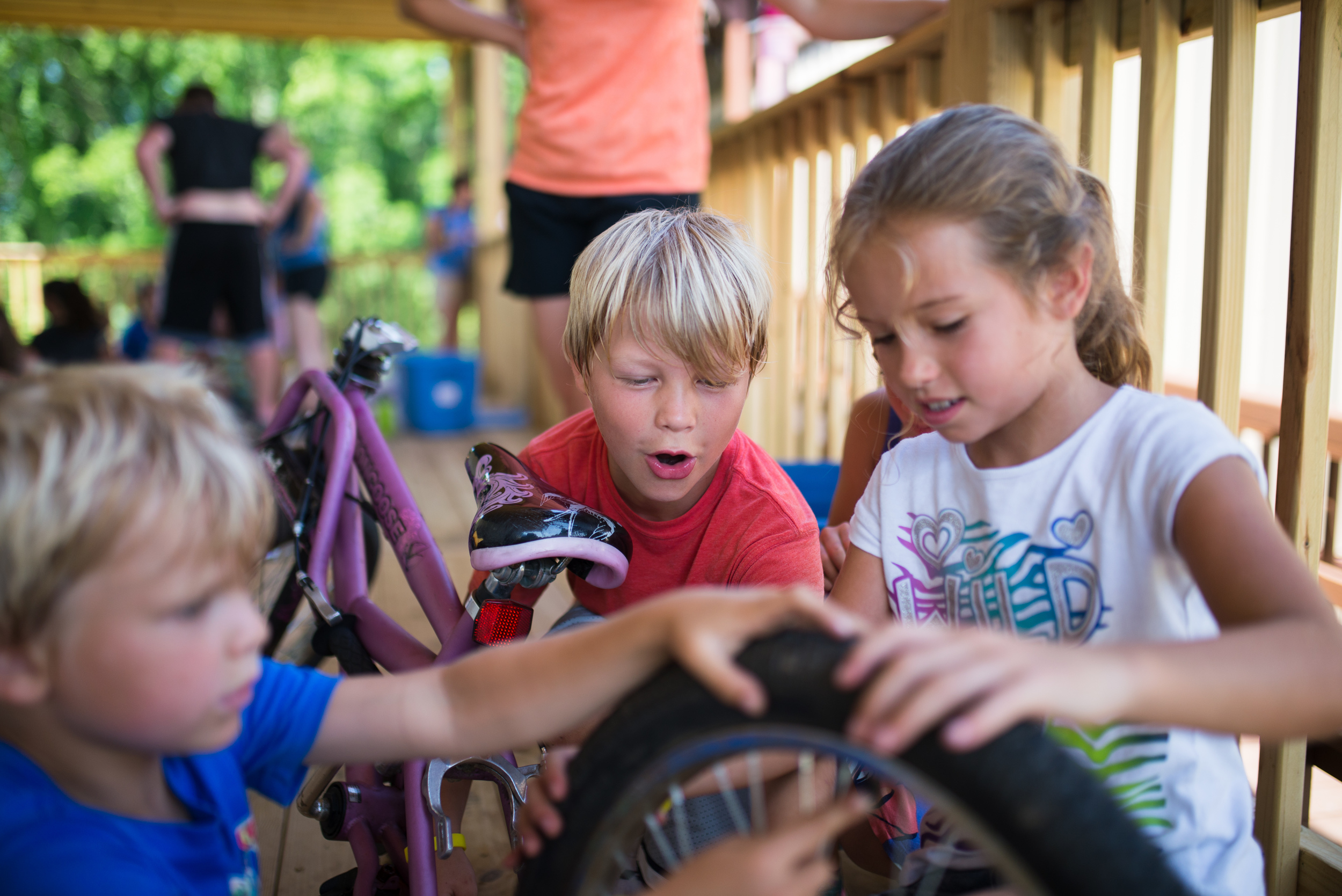 """Malachi Aaseby is one of the most hands-on learners in camp, and there's no wonder why he gets struck with awe in an event called """"fix it"""". Campers get handed an unconstructed item like a bike, a wheel barrow, or a fan, and they race against other teams to put it back together without the instructions. Talk about your logical, kinesthetic, and interpersonal intelligences exploding with joy and excitement. Camp Skillz events have to be fun (of course), but they must also be educational and contribute to skill development. """"Fix it"""" was a huge success this summer on many levels."""