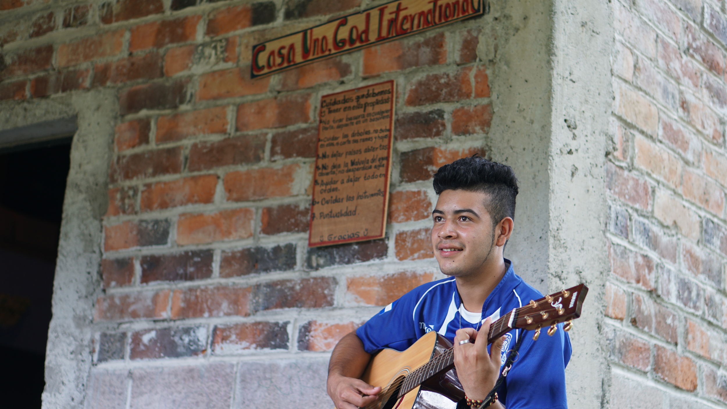 Roberto, a youth who lives nearby our property, has been learning how to play guitar at our community center, which features a music recording room.