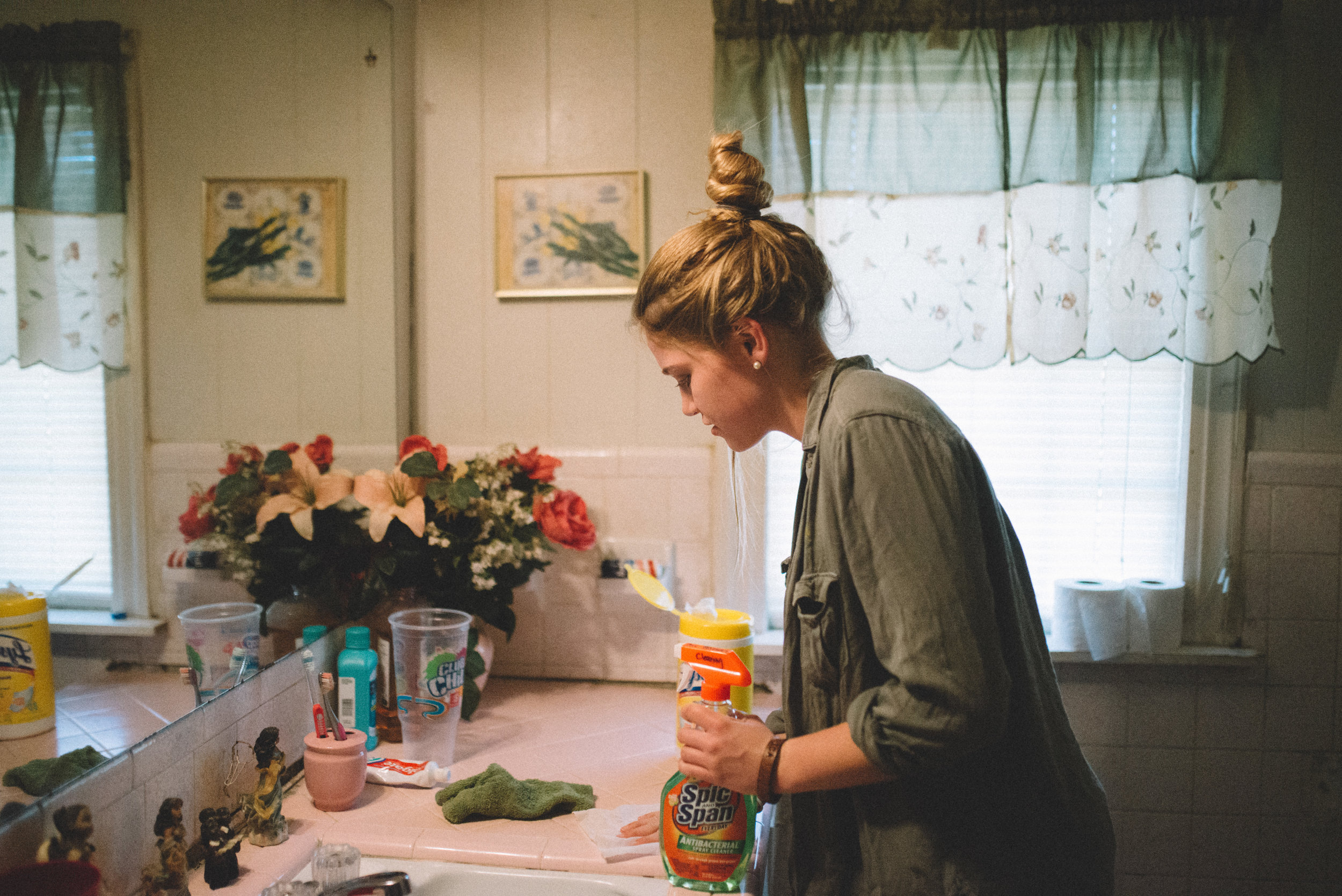 Institute student Amanda Byrd does a service to elderly neighbors by cleaning their home.