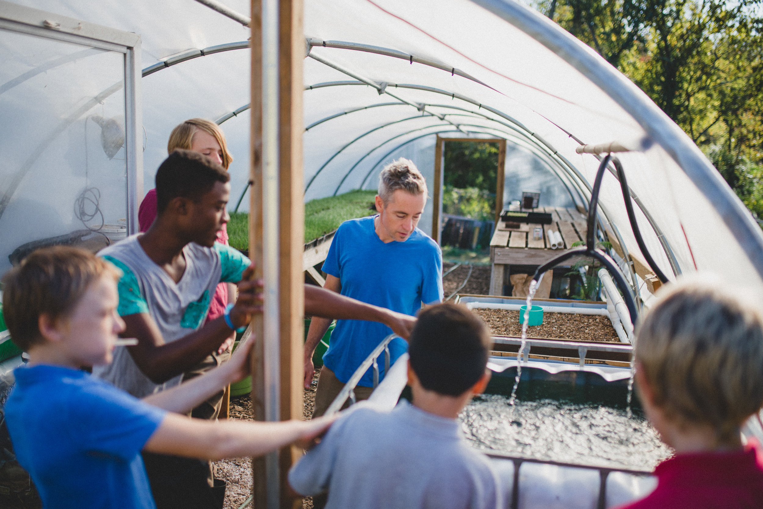 Junior high and high school students at the Academy for G.O.D. helped design, build and implement an aquaponics system at Hopewell Gardens. Nutrient-rich water produced by fish in the tank is transferred to assist in the growth of plant life in the garden. Watching the students take on ownership for an innovative project was truly awesome.