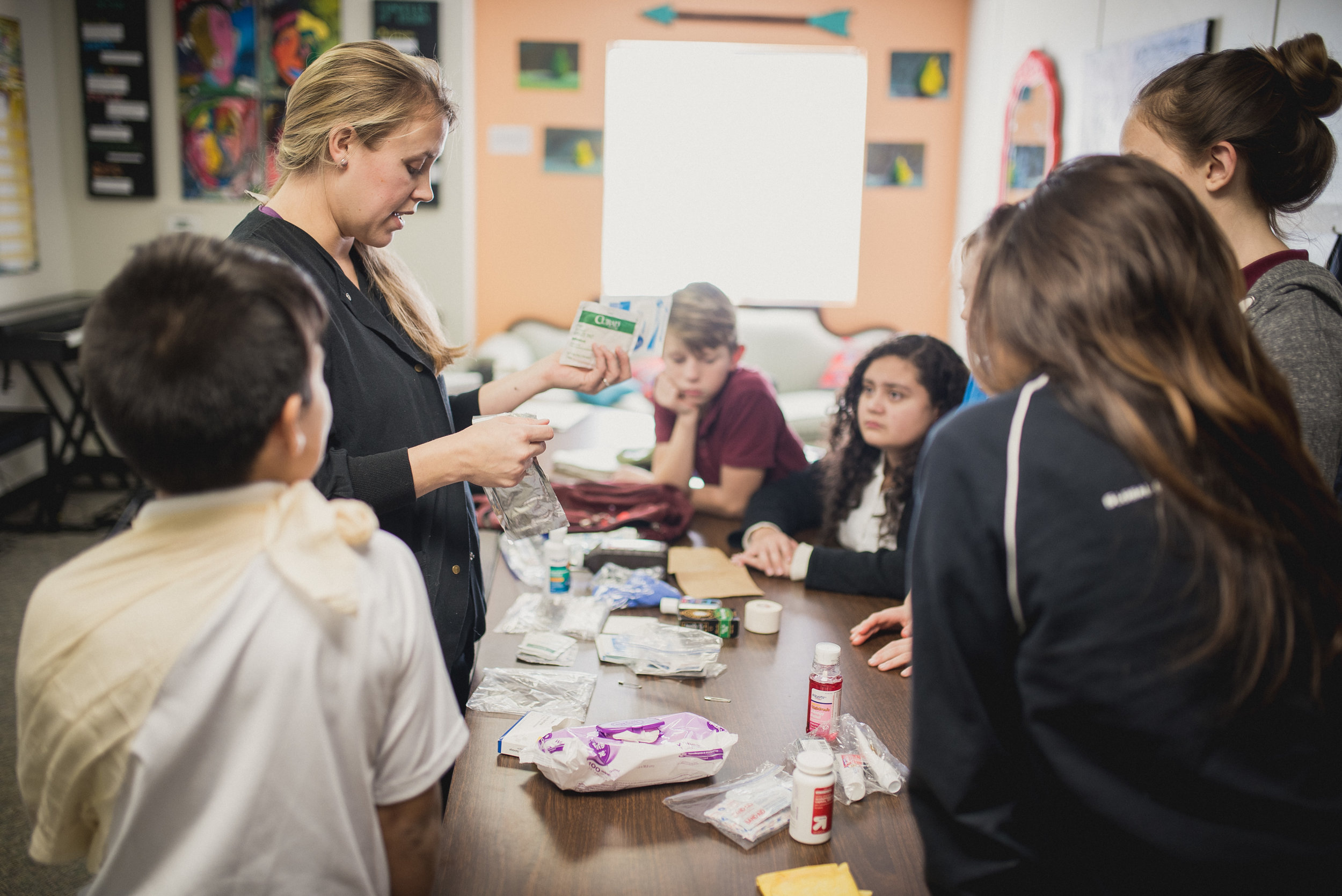 Amanda teaches a first aid class to middle schoolers at the Academy for G.O.D.