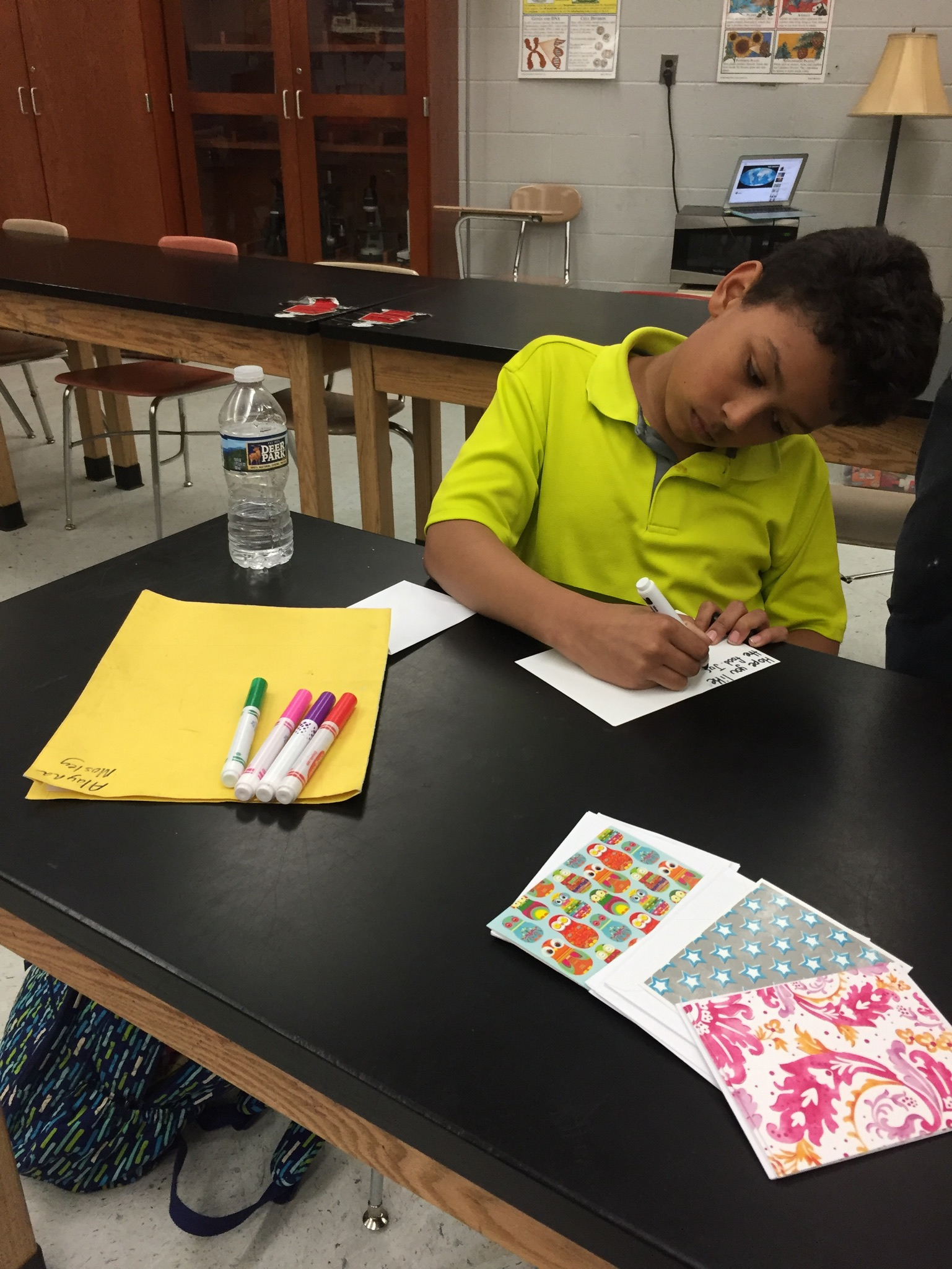 Students took time to write cards to the families receiving the baskets of food.