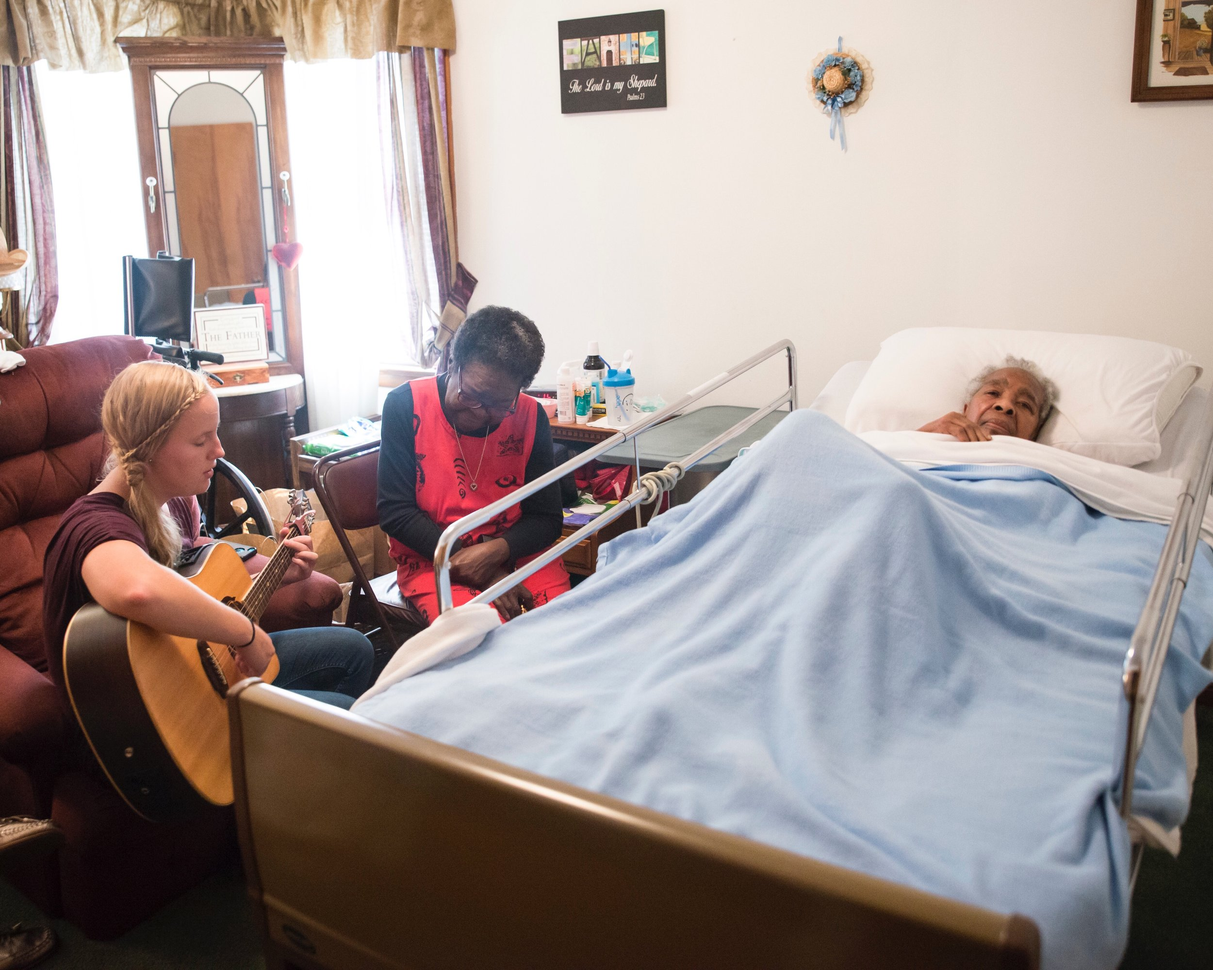 """Anna is a student of the Widow and Elderly Care class. Before she took the class she was doing the work of Elderly Care. Week after week, she assisted in the physical care of Mrs. Elizabeth. But it was when she picked up her guitar and softly played hymns that were familiar to Mrs. Elizabeth. that she realized the value of meeting deeper, less evident emotional needs. """"She may not talk for days,"""" said Anna, """"but when I begin to play and sing, she moves her lips and, even though it is just in a whisper, she sings the words to the song."""""""