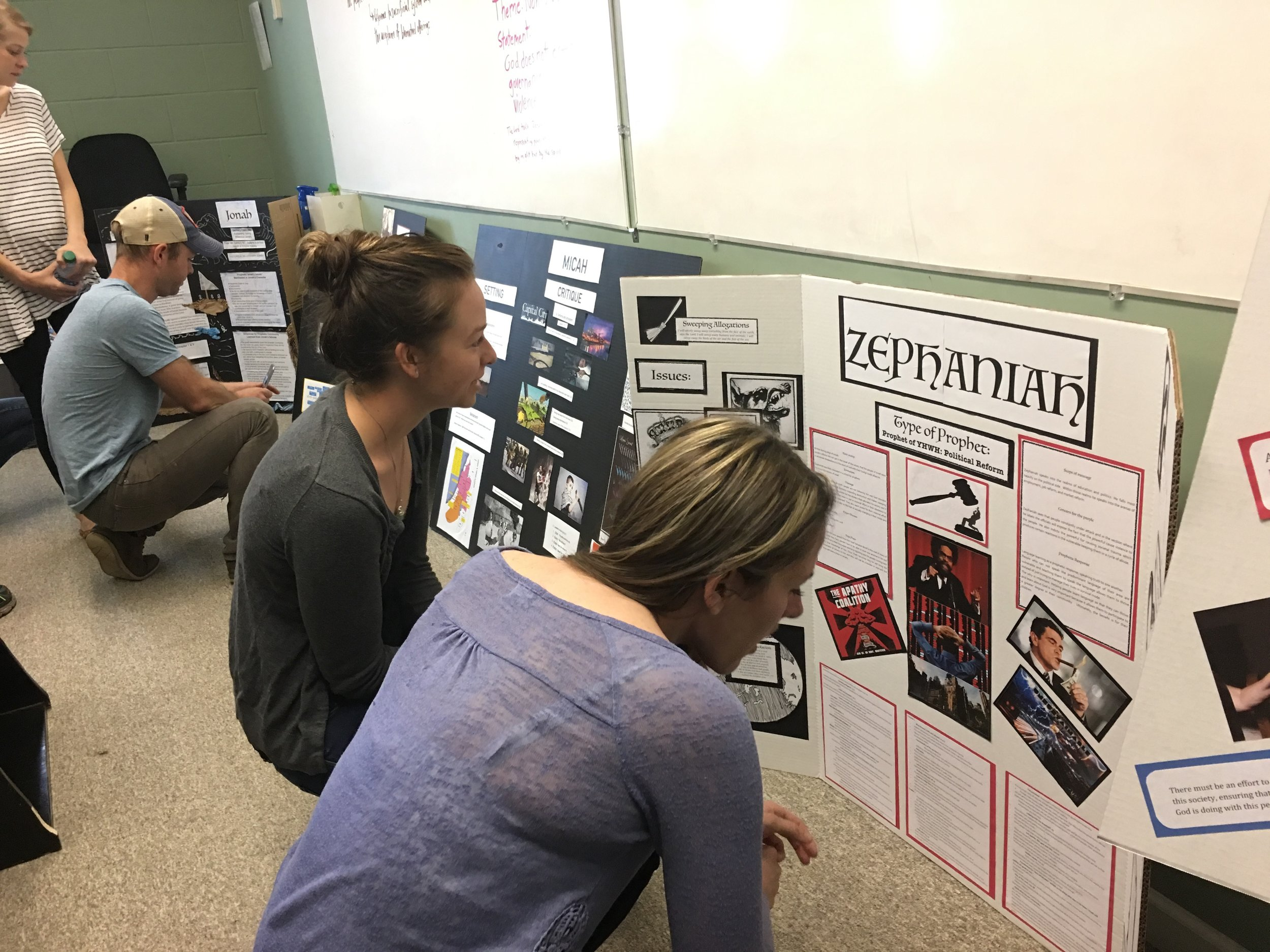 Students from  Prophets class observe one another's visual displays during the final day of class.