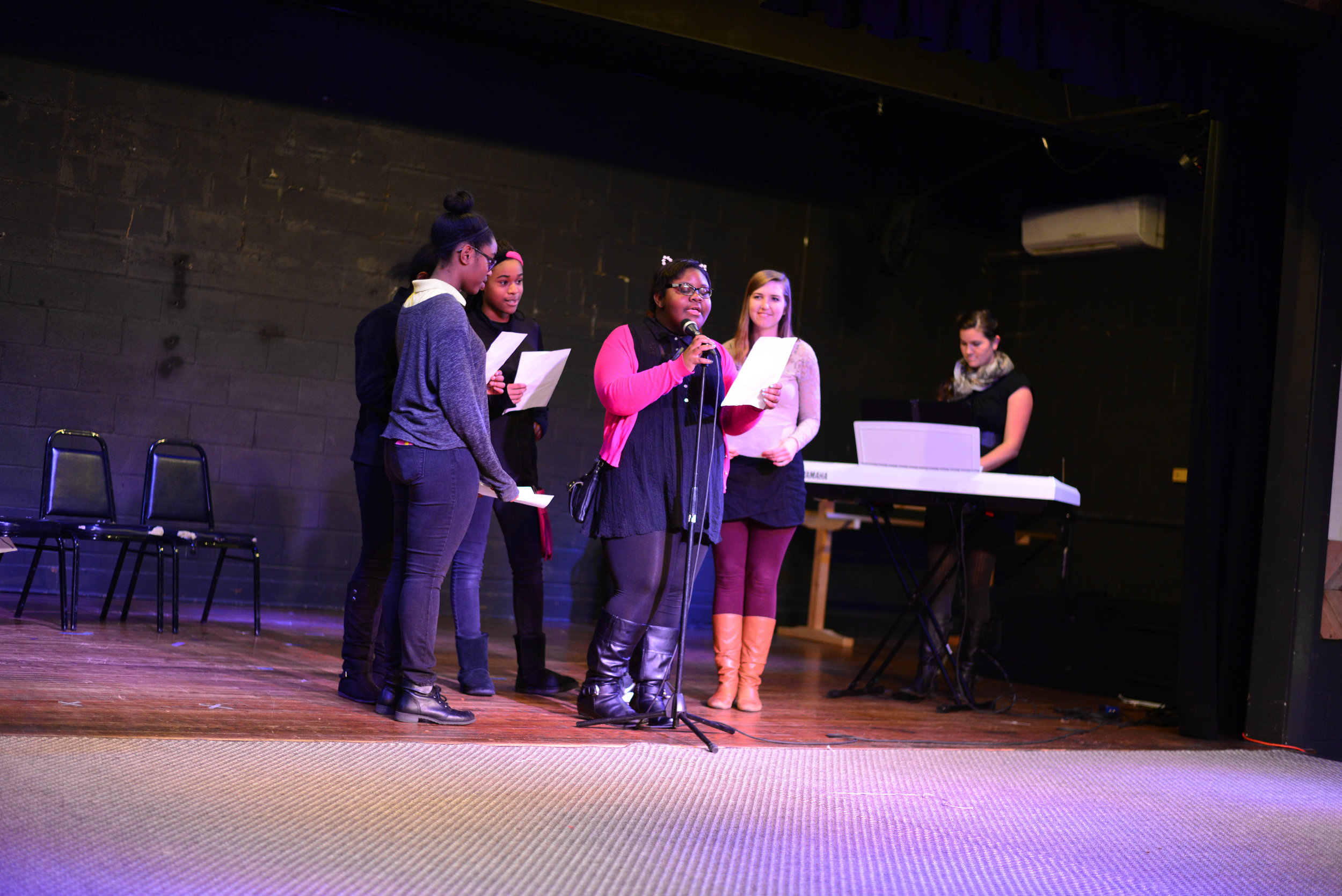 """A group of girls participated in a chorus group led weekly by Rebekah Davis. They learned various parts and harmonies, culminating in a performance of """"A Thousand Years"""" at our ShowCASE event."""