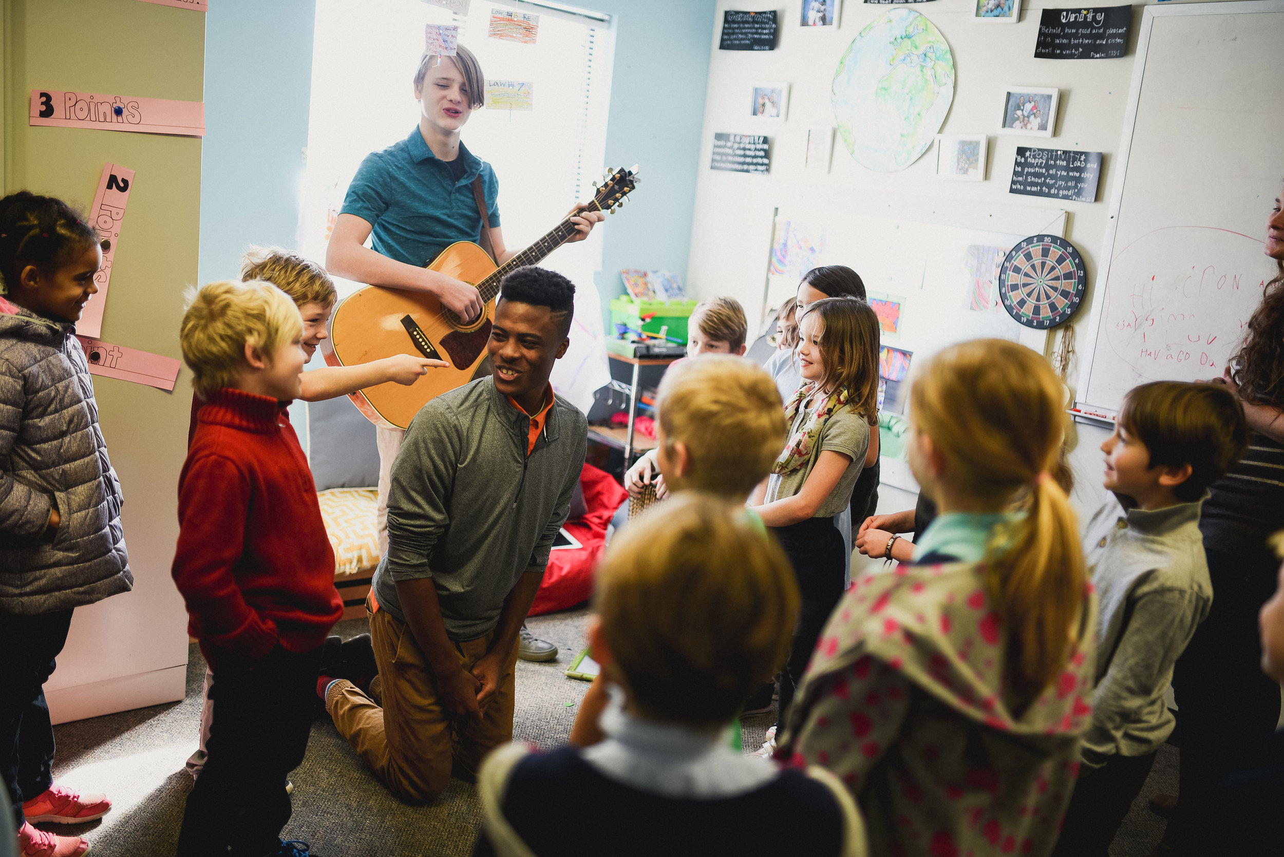 """One of the most practical ways we can implement the value of """"the older serve the younger"""" (Gen. 25) is by example. Each week, our Junior High and High students facilitated a time of morning worship for the younger elementary levels. It was a highlight of the week all around!"""
