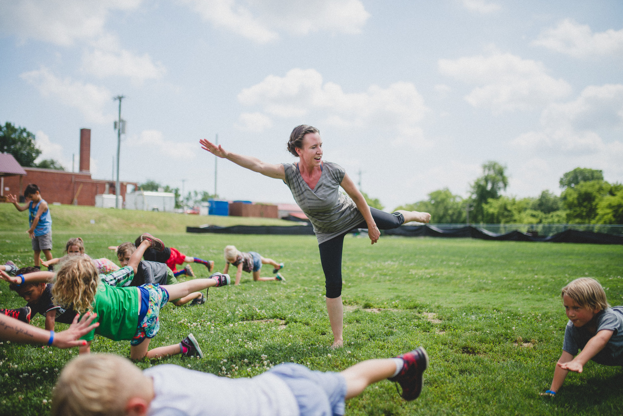 """Sarah Corniea, certified Yoga instructor said of her time with campers, """"Yoga poses a challenge to the campers as it requires mental focus to get their body to move into stretches and balancing poses. It is a joy to see campers come out of their comfort zones and learn how to focus in the moment and become aware of how their bodies move!"""""""