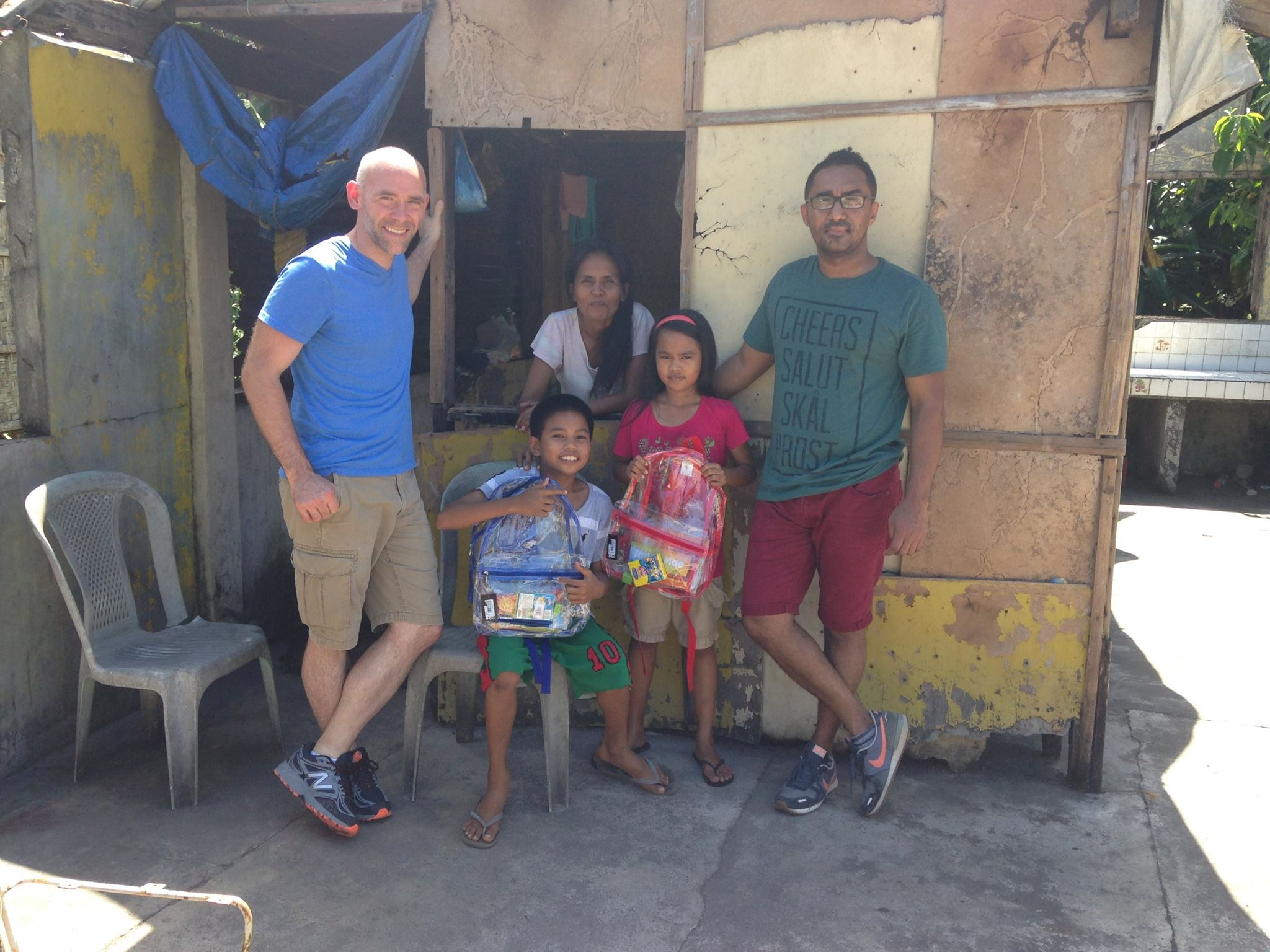 Keith and his friend Mo delivering some school supplies to a family of children in need in the neighborhood.