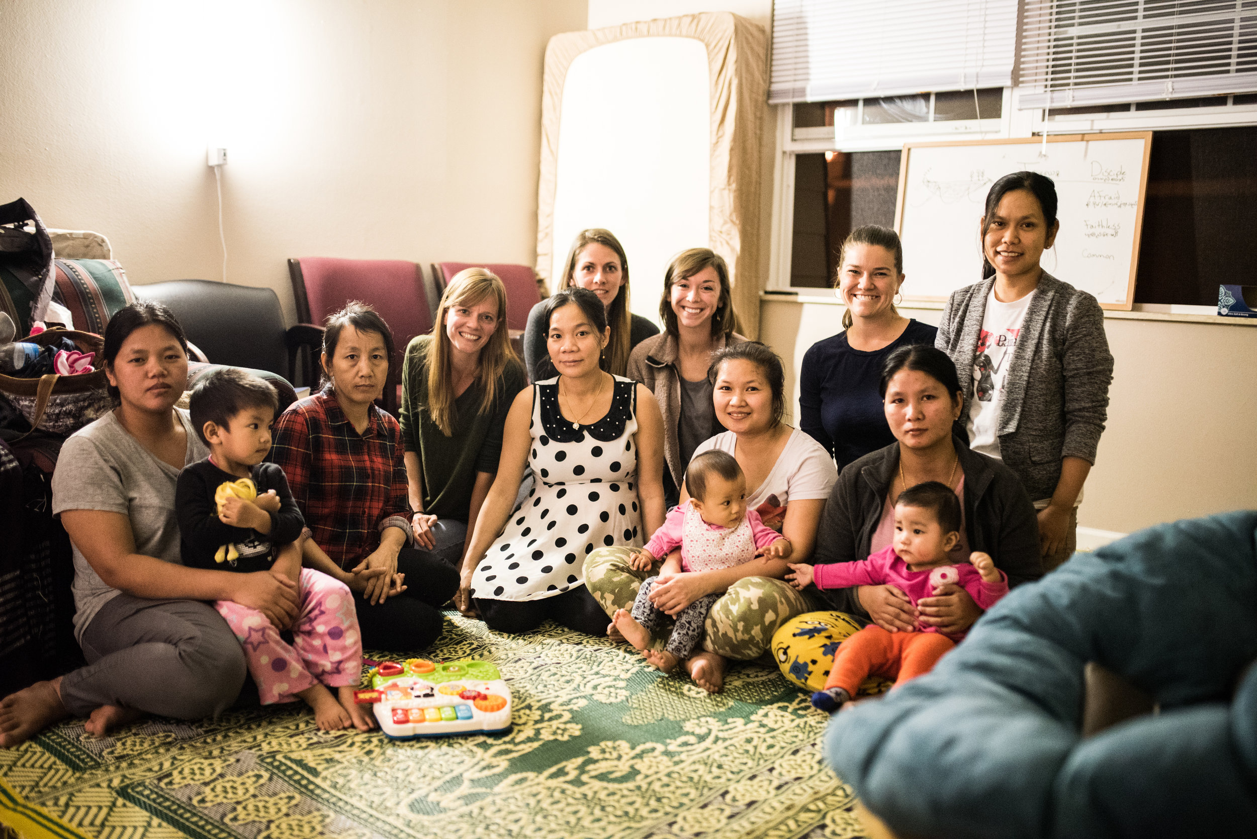 Participants in a 2016 Bible study. Various community members from G.O.D. would facilitate Bible study and prayer, as well as offer childcare for the mothers so that the women could concentrate.