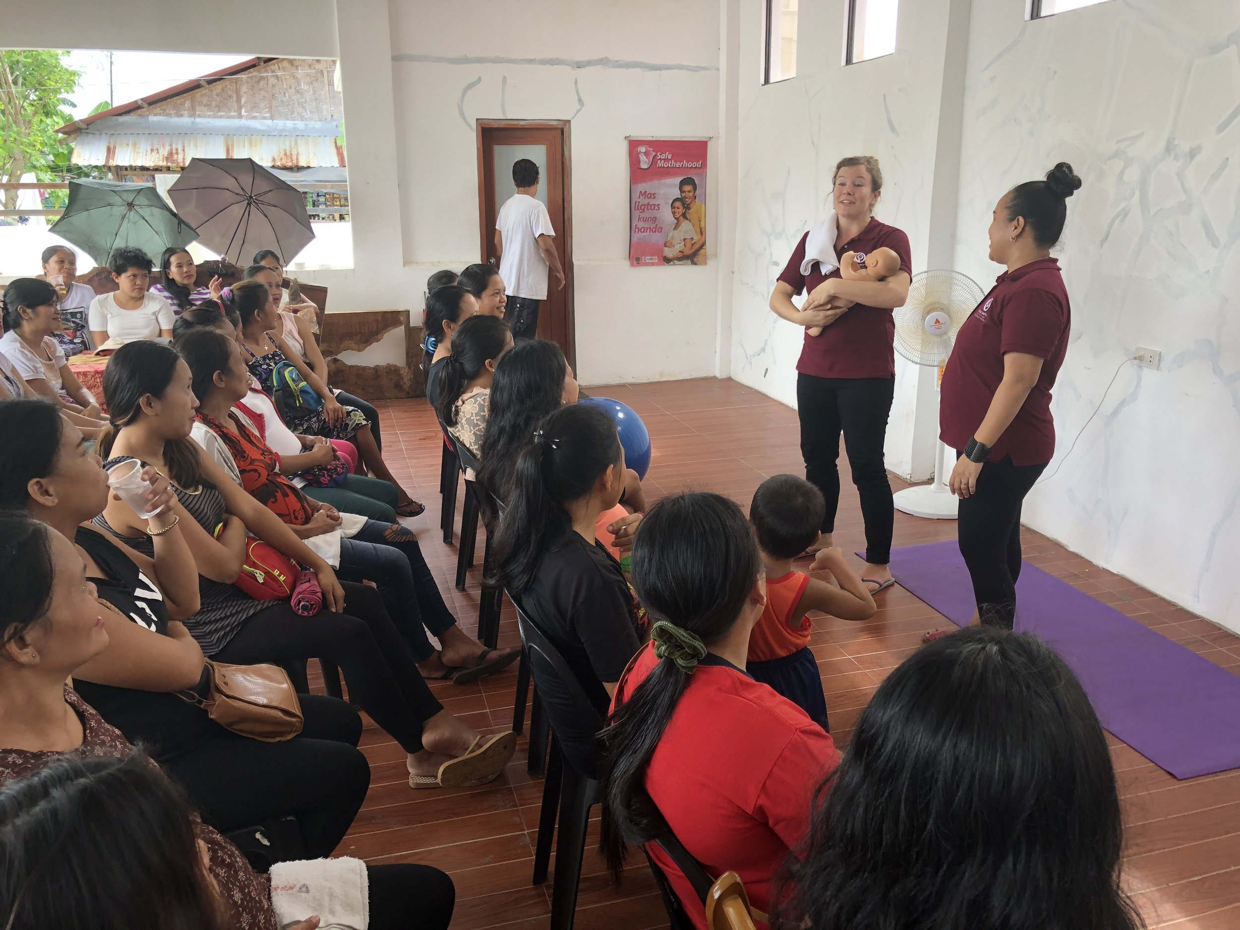 Julie Carpenter teaches at a labor seminar at the Cumpio Midwife Clinic, a clinic that supports mothers who often can't afford the care they need surrounding the birth process.