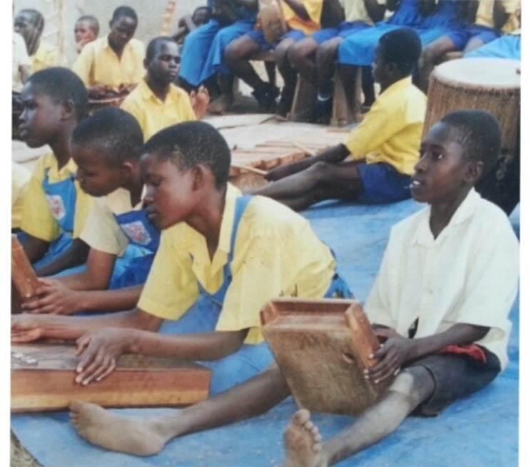 Moses Ssekabira, far right, made his way through primary school largely due to his musical ability.
