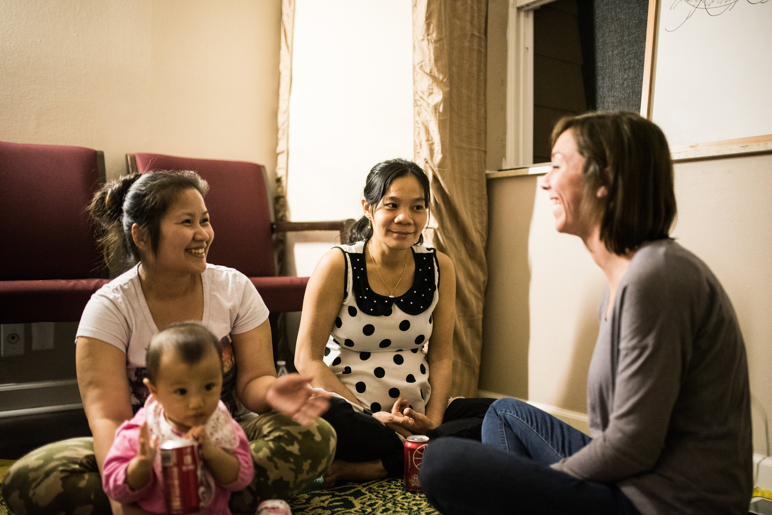 Internship ignited a desire to service in Leah that continues to bear fruit.She now serves as a doula and has offered her services free of charge to refugees. Pictured above, she assists during a bible study offered to Burmese refugees.