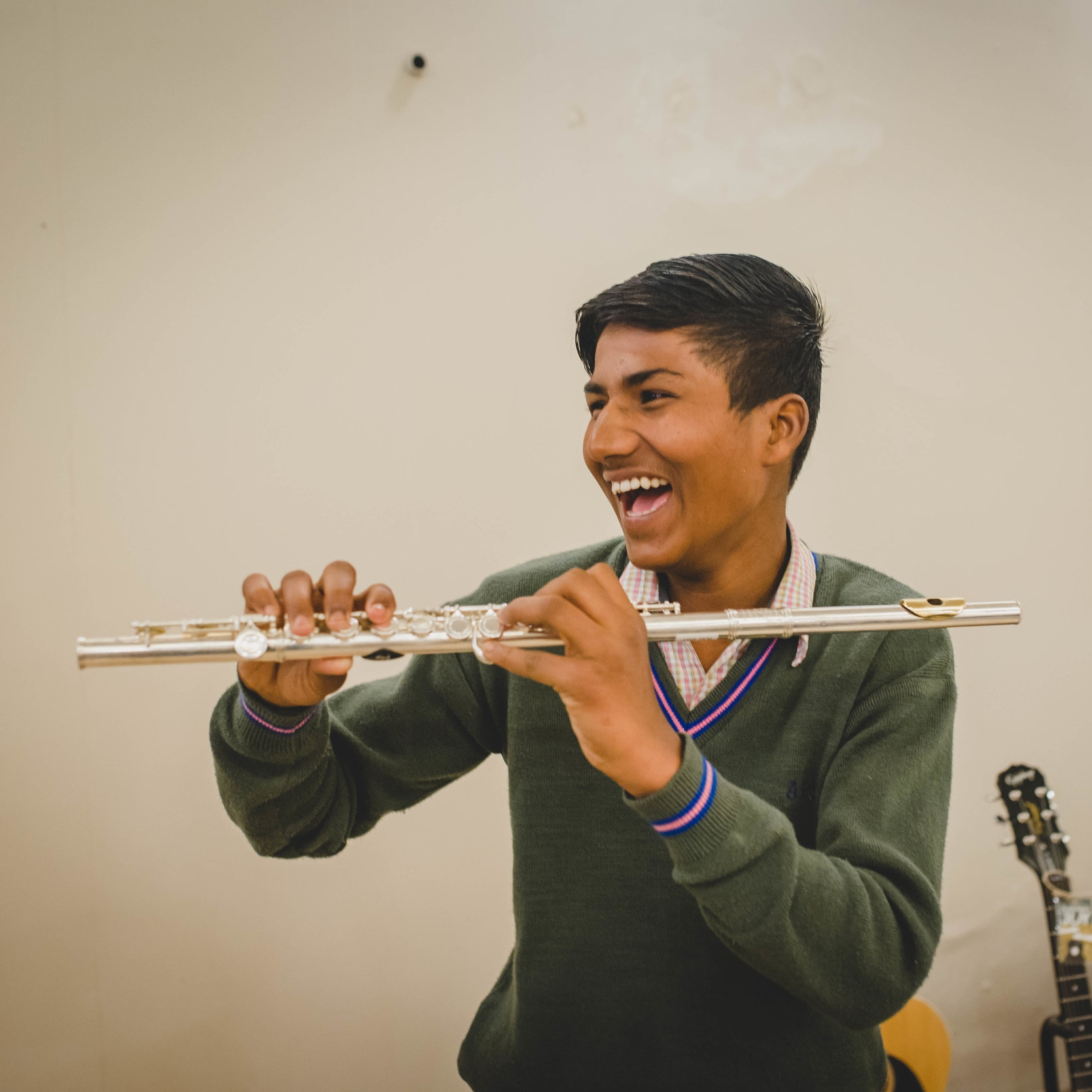 Atul, aged 15, couldn't help but smile as he held a flute for the very first time.