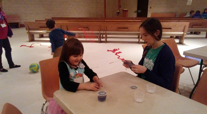 """Merci Warren, Academy for G.O.D. freshman, helps with an arts and crafts activity during Buddy Break. She says, """"I've loved serving kids and giving them a great time!"""""""