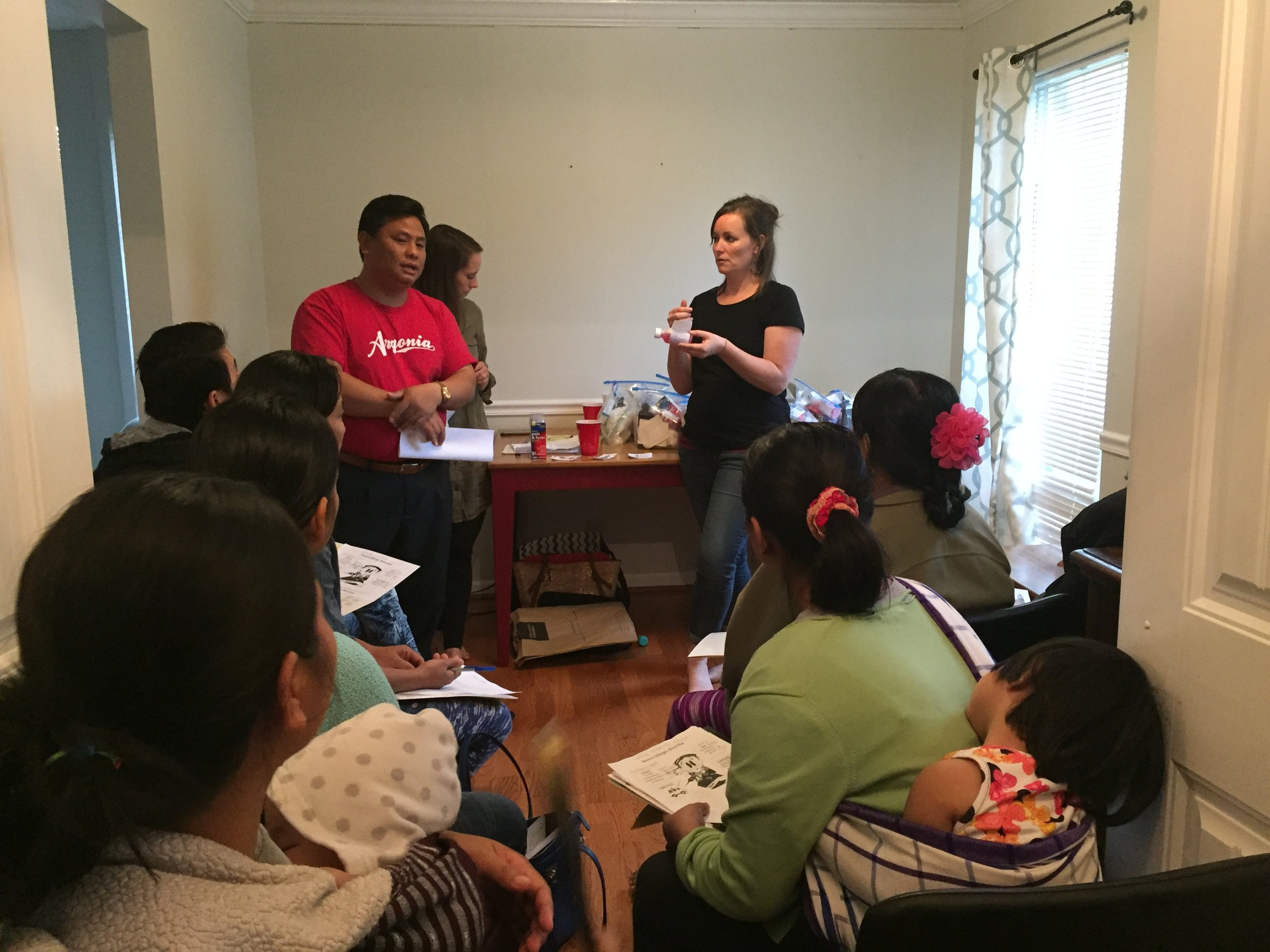 Jennifer Sherrod teaches mothers how to use a thermometer that displays numbers different than the Burmese script.