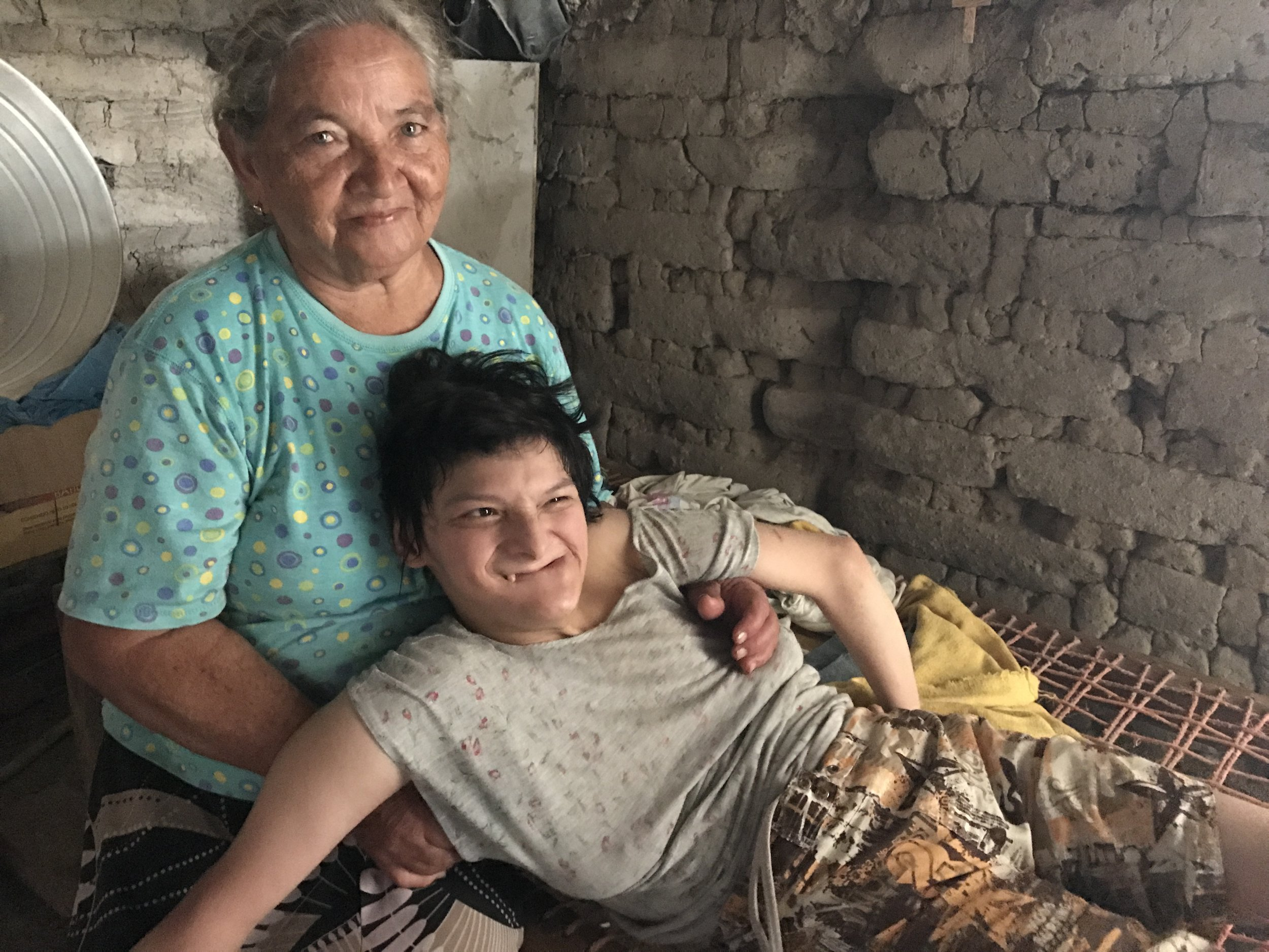 Antonia, a widow in her 70s, cares for her daughter, Angelita, who has cerebral palsy. The interns visited with them, bringing them food and songs.