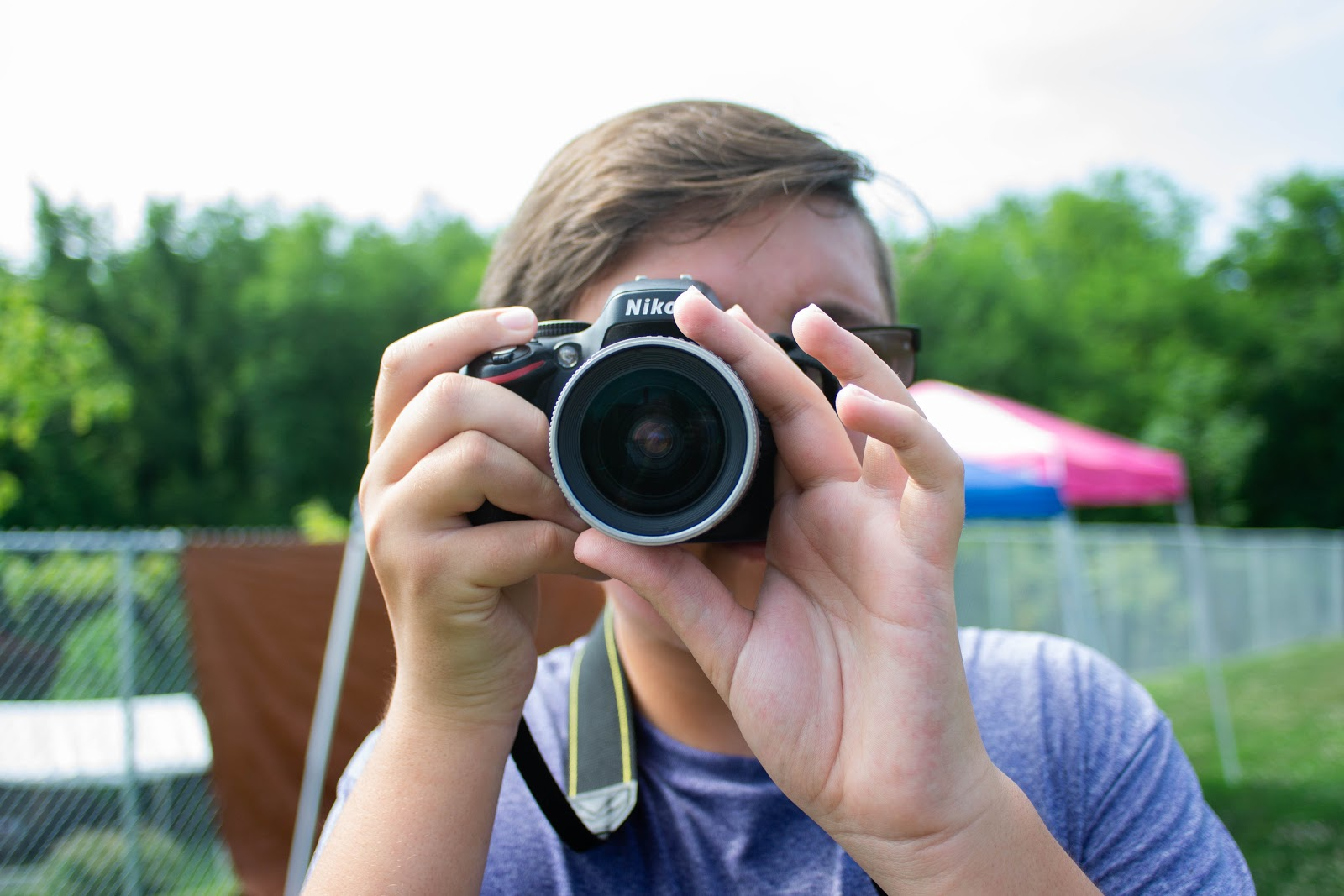 Employee Logan Rast entered the WorkWell program with no experience in photography and now has learned how to operate a professional camera!