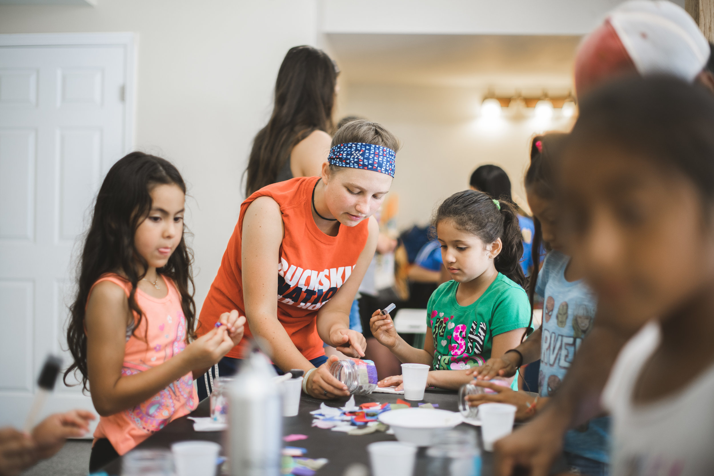 Metzler Mennonite students assisted in a candle-making workshop for kids at Camp Skillz Madison.
