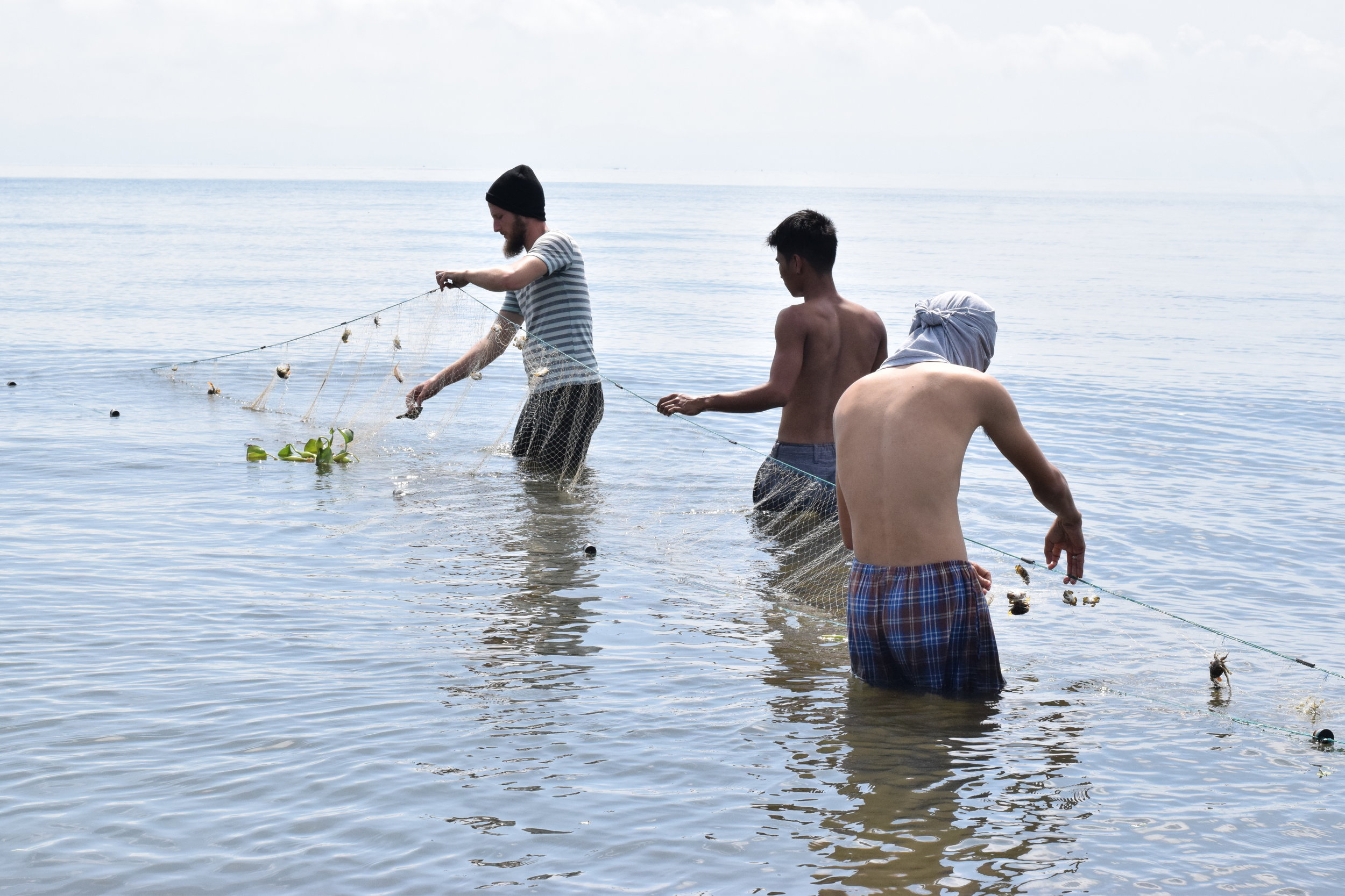 Clark Miller and Jairus Tumamak fish with the Fisherman Folks Association nearby Tahanan, learning not only about this particular group's occupation but also the cultural practices shared among them.