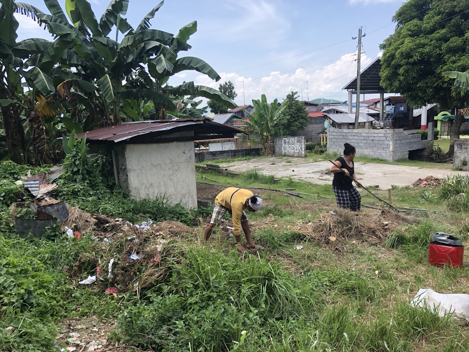 Tahanan ministry personnel spent the morning working to clear trash and brush at the village's elementary school as a small way to bless the community.