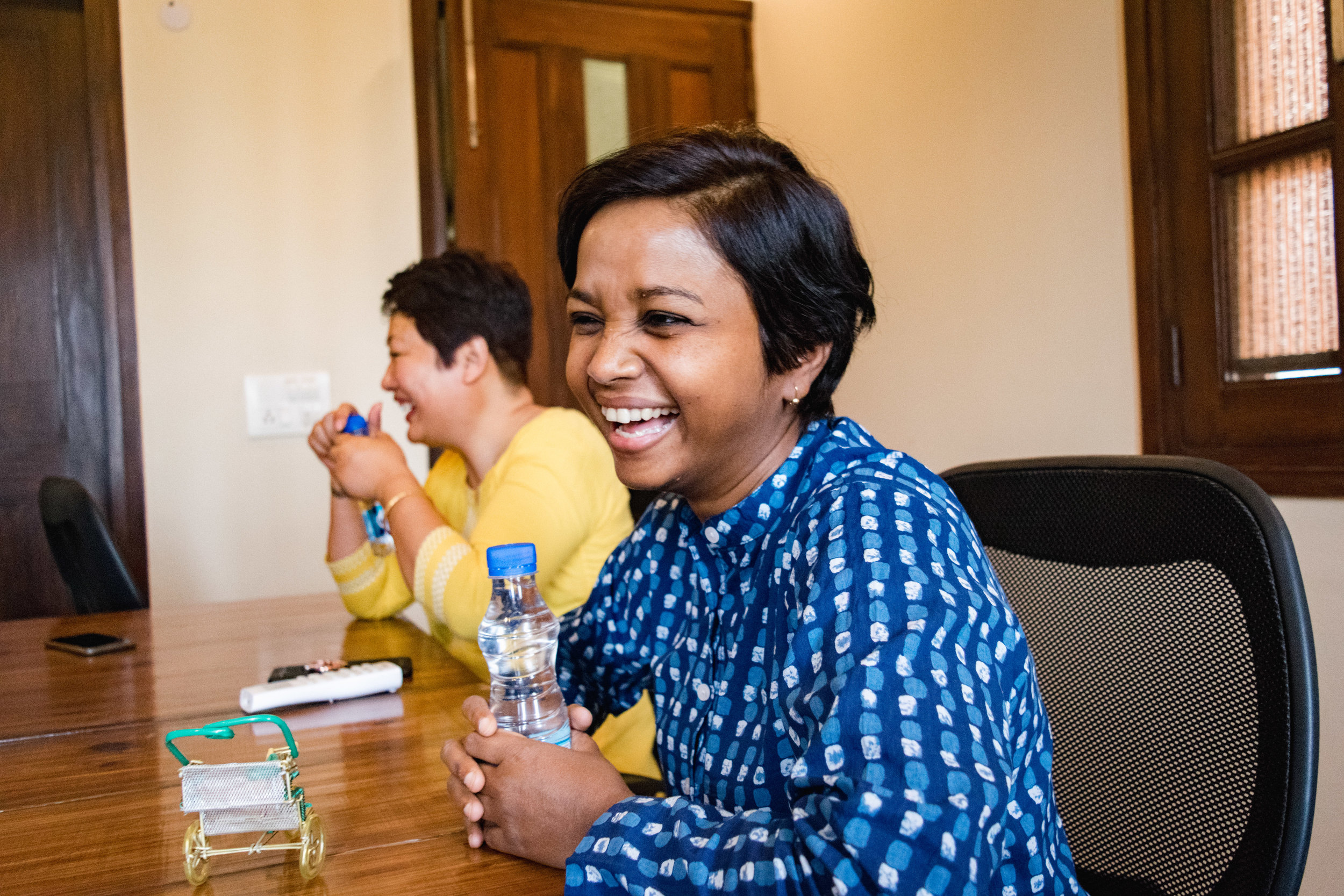 """All of our staff are involved in the facilitation of our weekly time of fellowship. Manohar wrote, """"Each one of us have taken up this responsibility willingly and give 100% to ensure we have everything ready for the gatherings."""" Sneha, pictured above, welcomes new attendees, ensuring they feel comfortable and at home."""