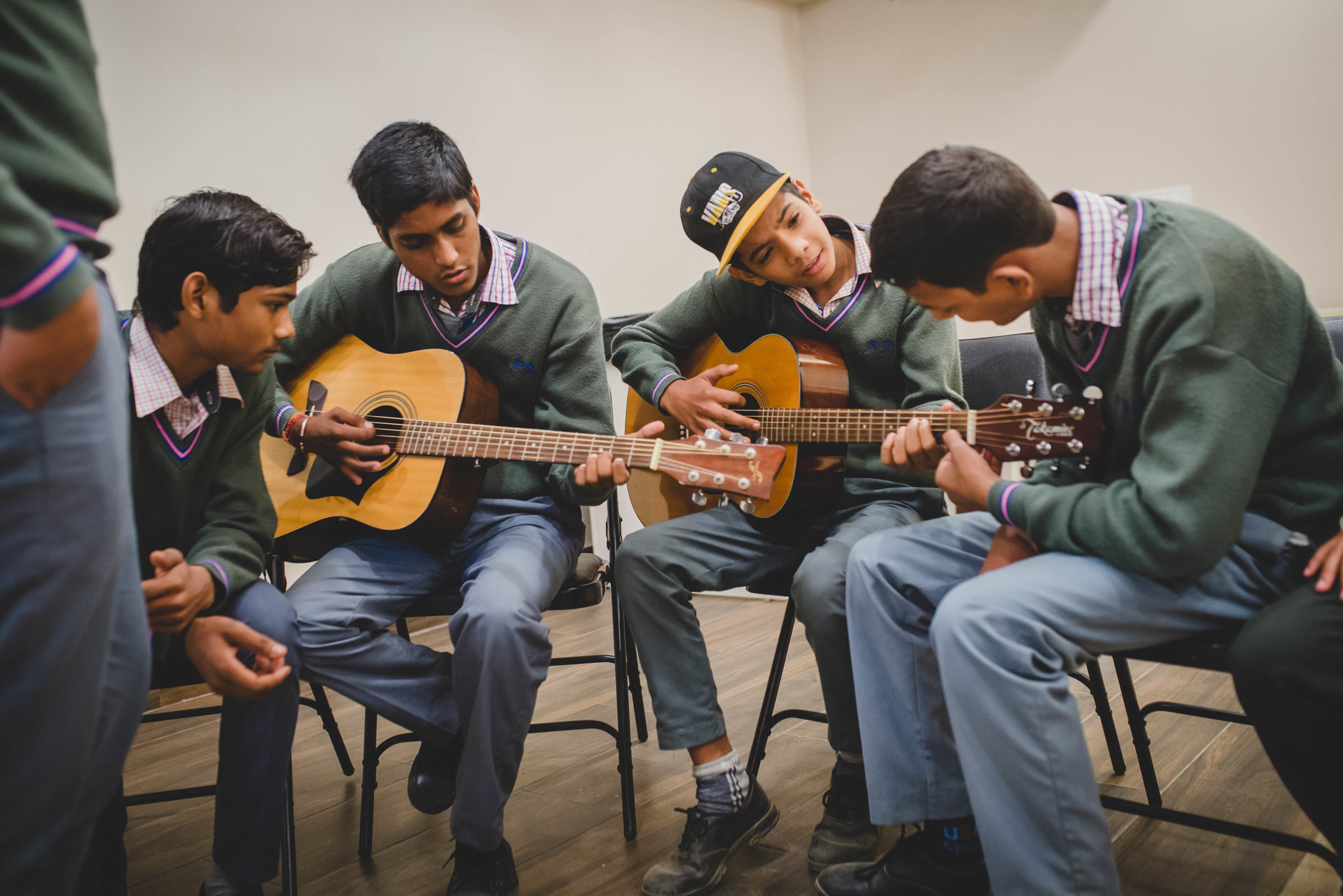 Manohar Paul teaches a music class to boys at our office in Gurgaon. Manohar approaches this class as a time not only to teach music, but also teach on topics such as stress management and character development.