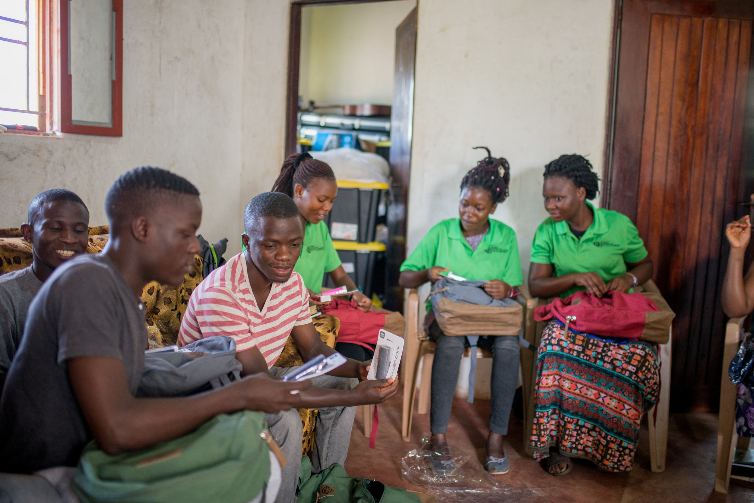 Students at the Institute for G.O.D. East Africa look over gifts that had just been distributed to them: backpacks, embroidered polos, pens and books —necessities to accompany the gift of tuition already supplied to them.