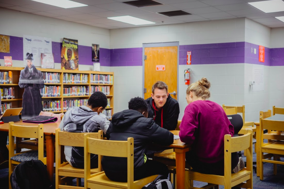 Homework for many middle schoolers can be a daunting task. CASE Volunteers Jesse Grooms and Chelsea Waldron, students from the Institute for G.O.D., are there to help.