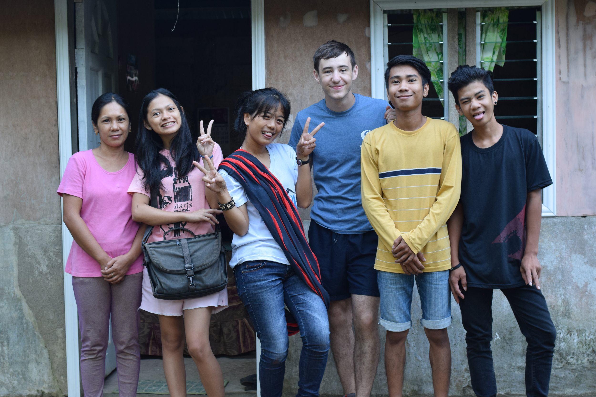 Immersion team participants and GOD SEA interns visit Jairus' home in the village of Kauswagan to visit with his family and learn the characteristics of rural life.