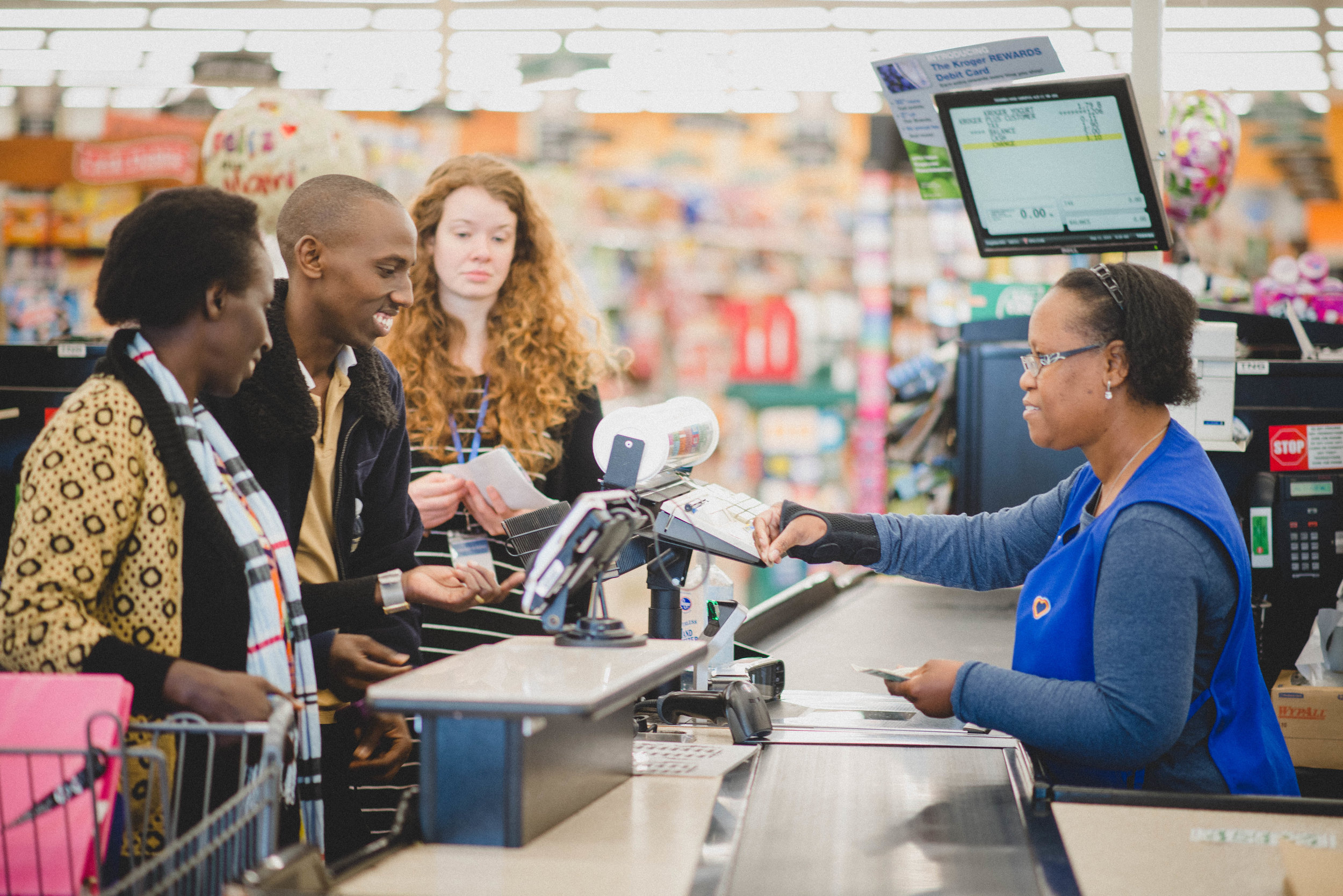 Students practiced the English they had learned to go through the checkout process at a local grocery store with confidence.