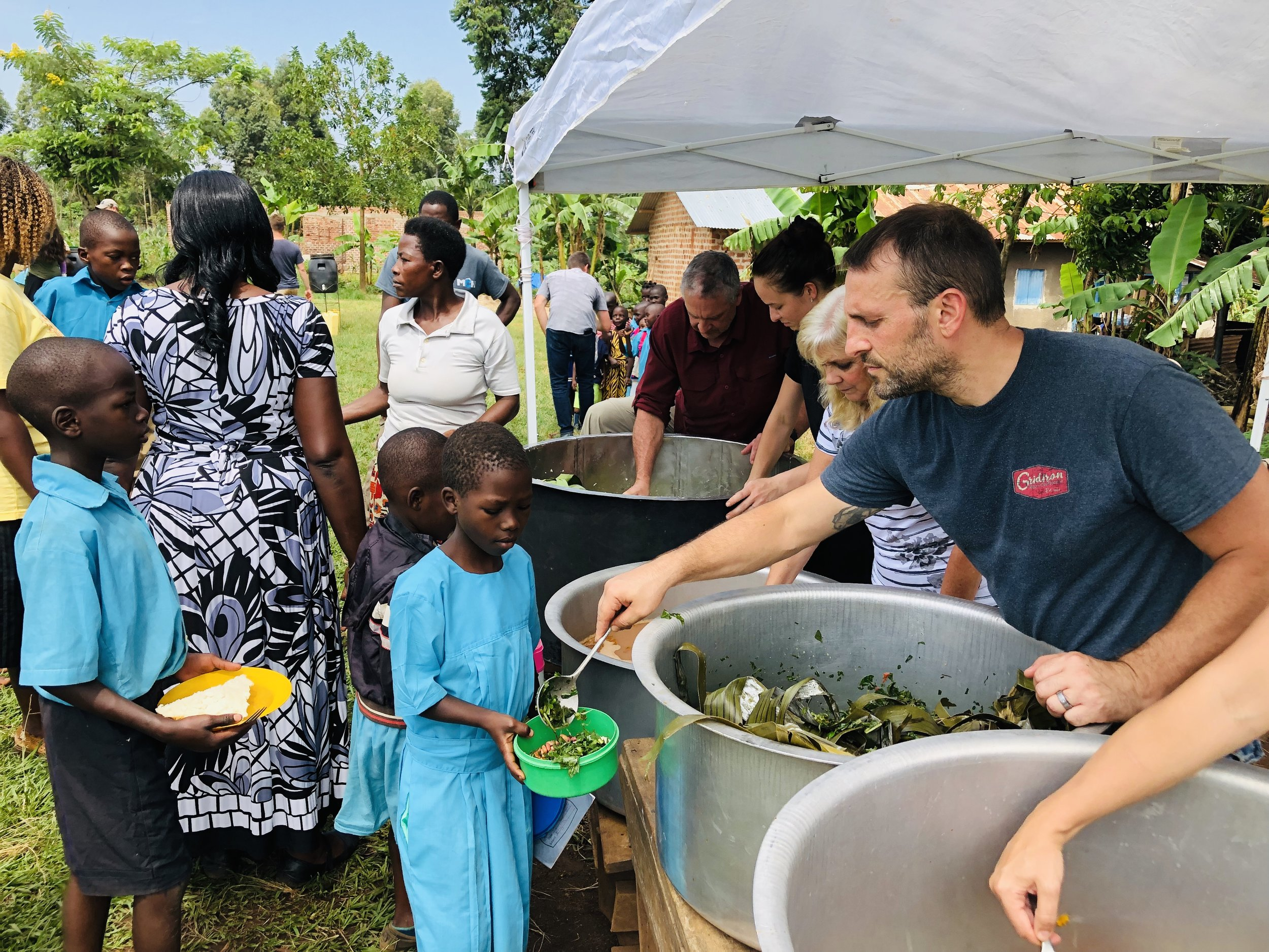 While G.O.D. has employed farmers to grow food and given assistance to the school cook, preparing and serving the food still depends on volunteers. Last week participants in the Family and Friends trip were able to harvest, prepare and serve lunch.