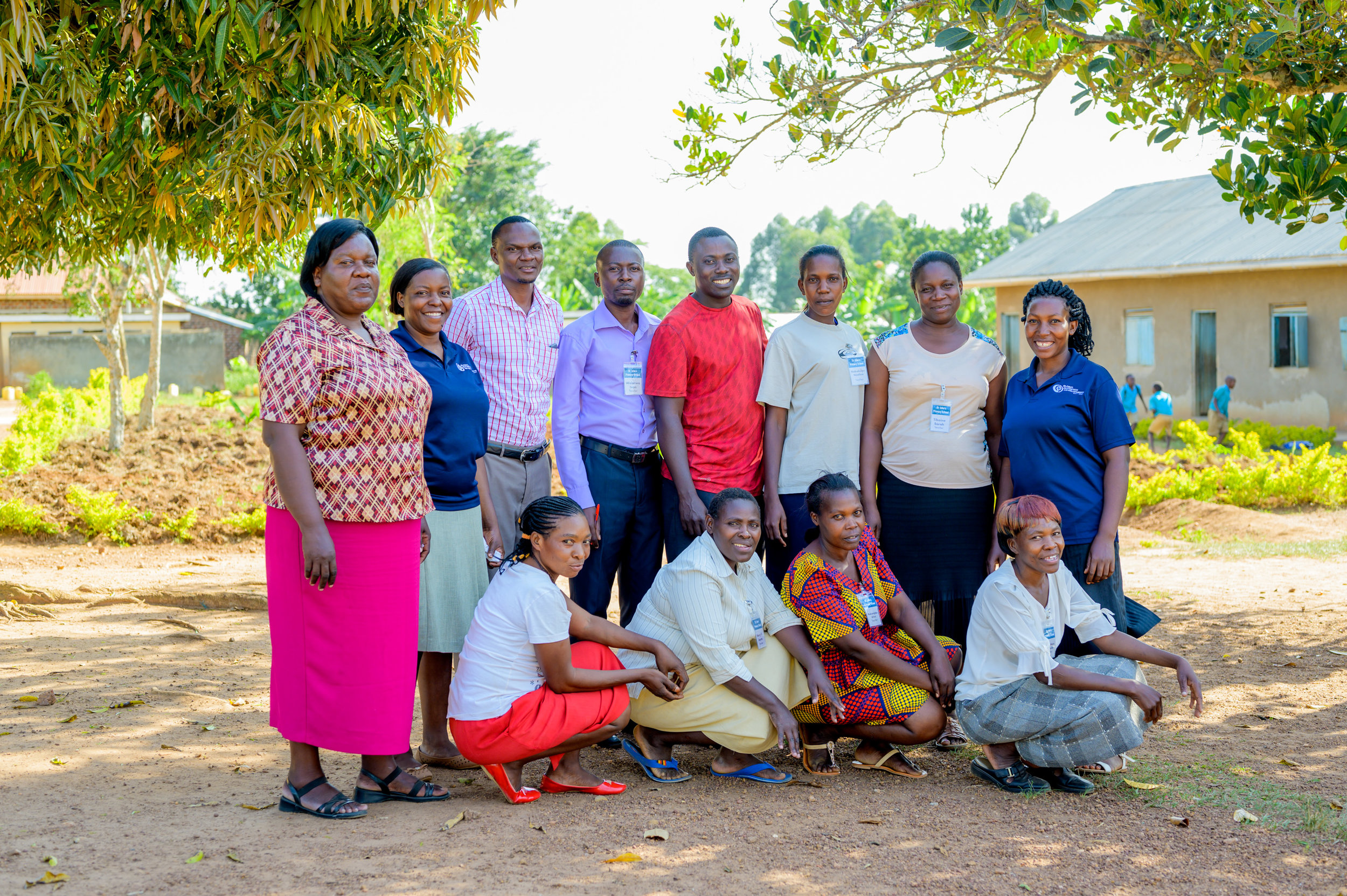 Teachers at St. John's school in March of 2019. Lawrence Ssemakula, G.O.D. Director of Education in East Africa, is in red at the center. His wife Josephine is standing second from left.