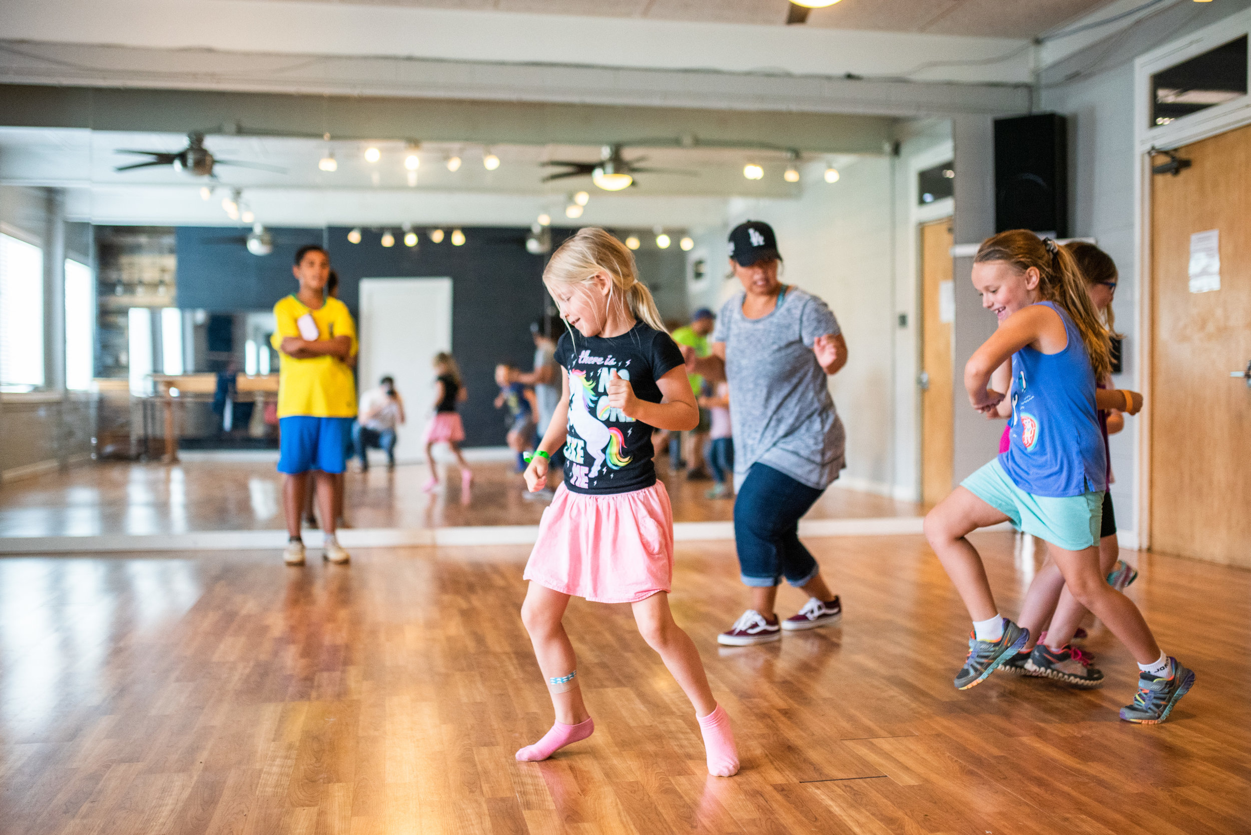Trinity Garner leads a hip hop dance workshop with campers. Movement of the body in connection with your soul is a healthy practice for everyone.