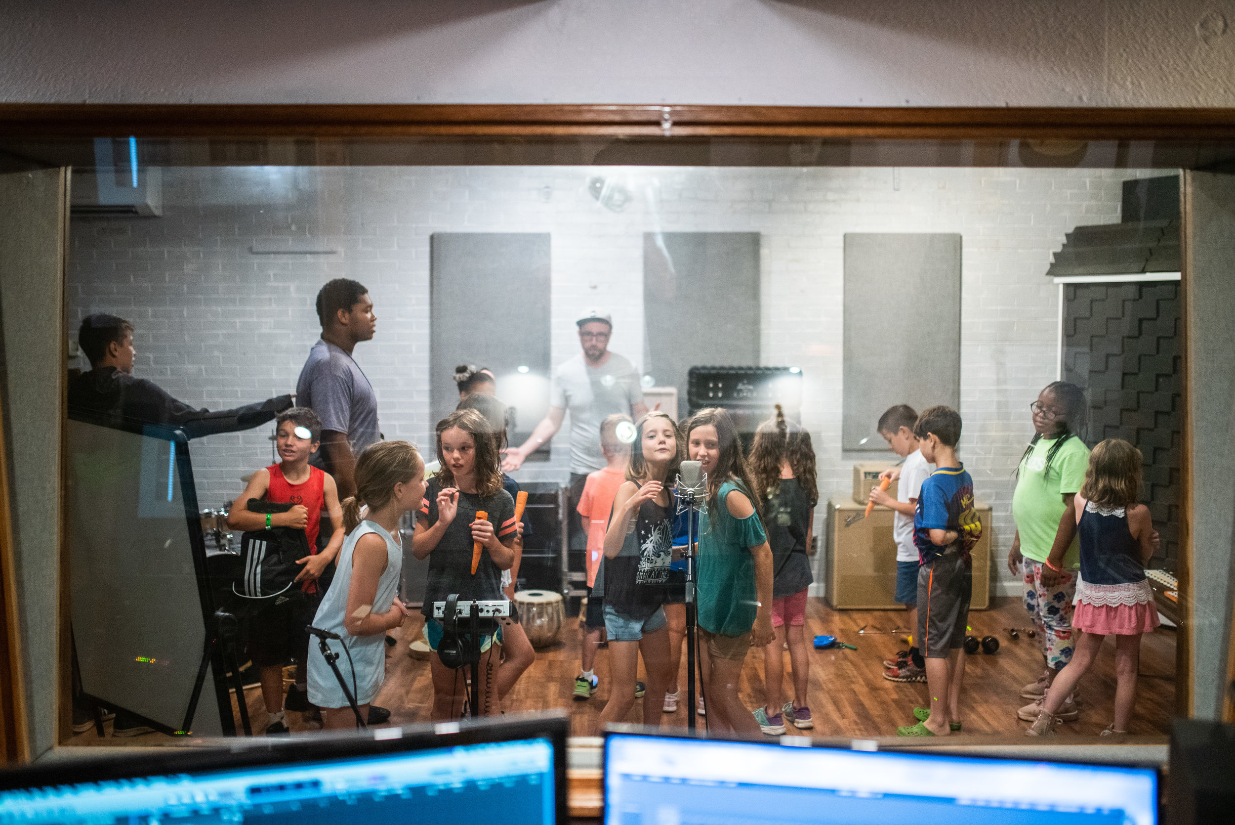 Students worked together to record a group song with Audio Engineer Shane Drause at Center Street Recording Studios. This activity revealed the important part that each camper played in producing a song.