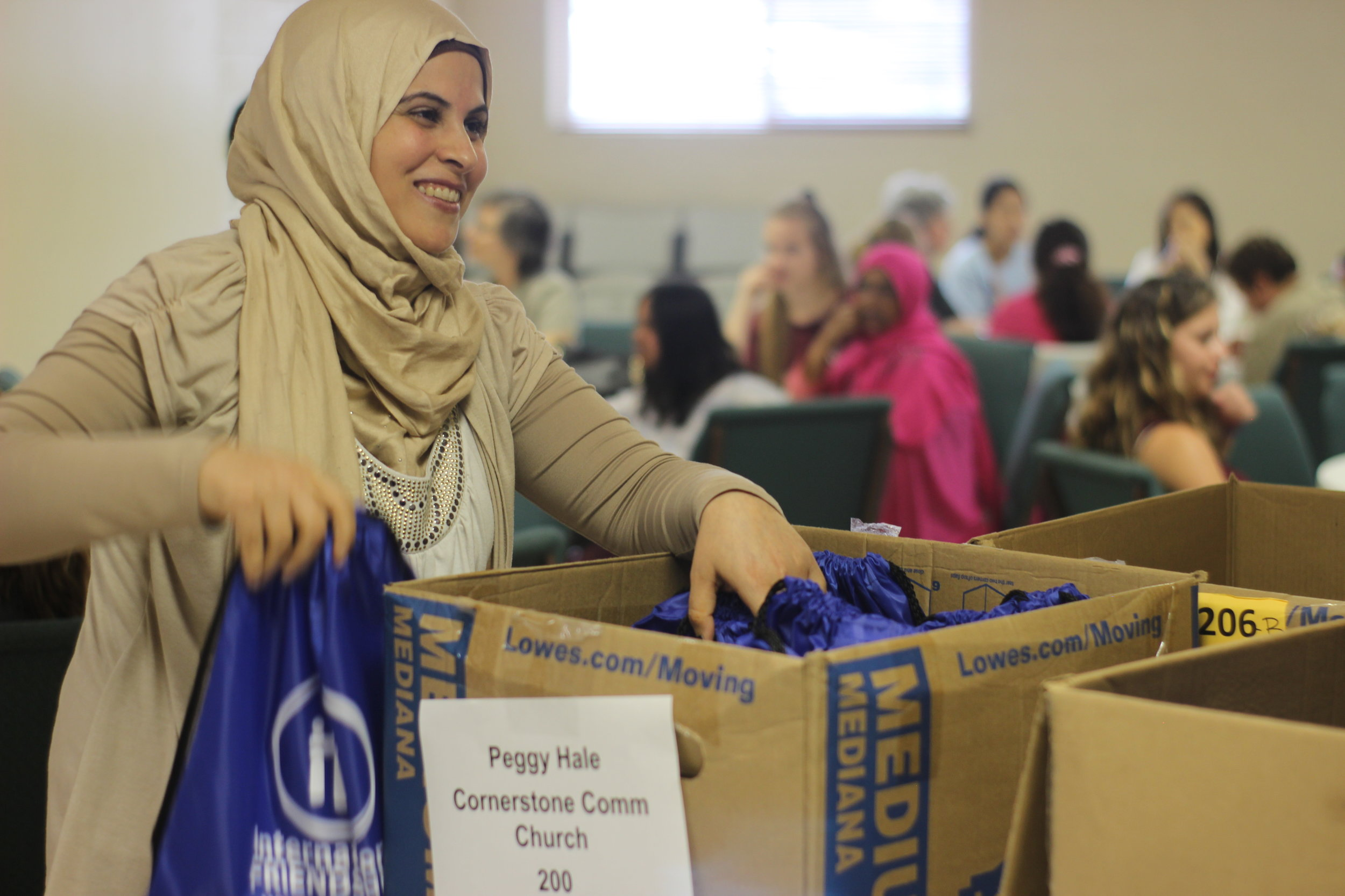 SLAM participants helped the refugee women put together backpacks for new international students attending Ohio State University. Simple things like gathering school supplies can be difficult when you don't know the language or where to shop for items!