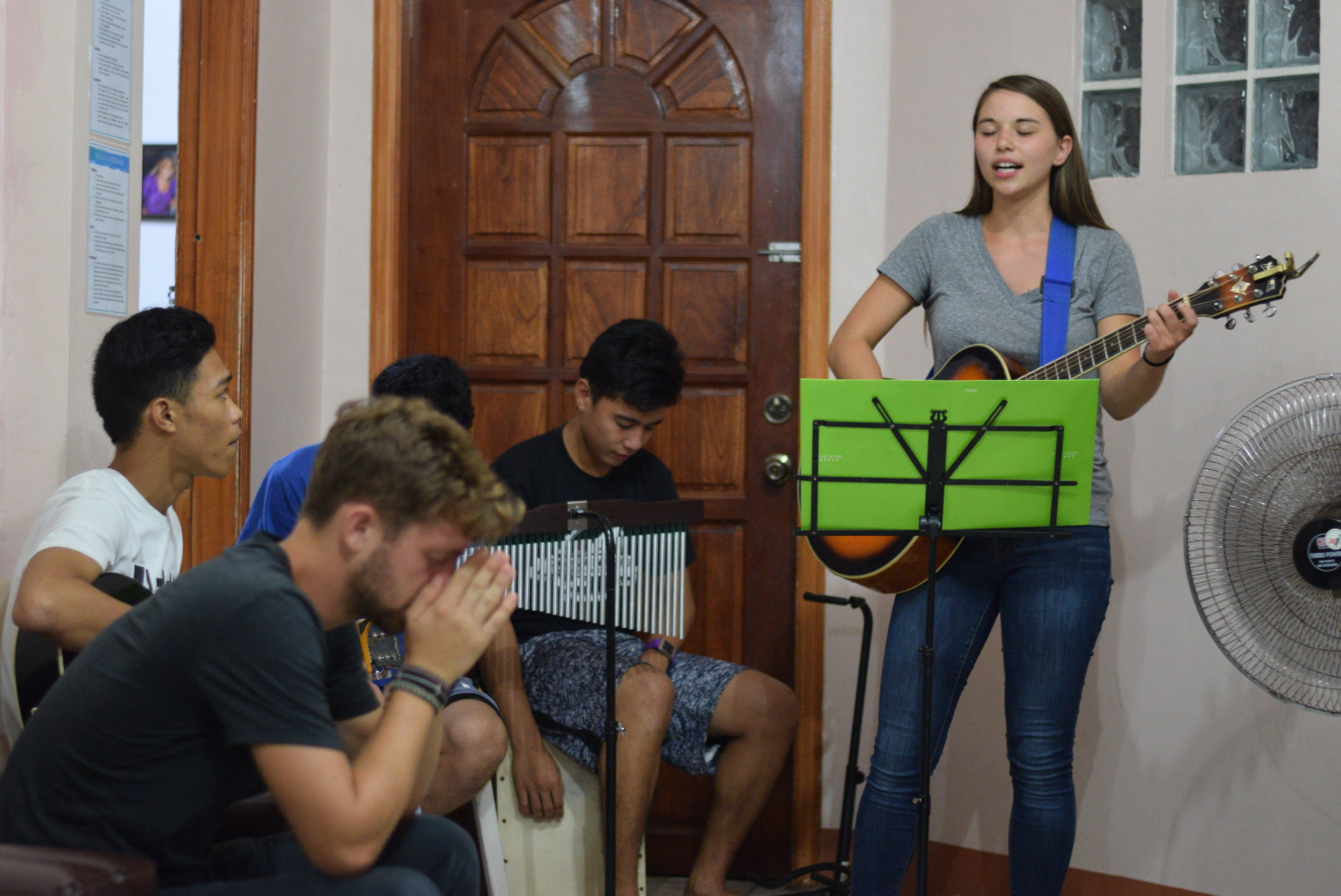 Brittan leads worship for a weekly gathering at Tahanan. Youth come to Tahanan throughout the week for times of worship, fellowship and bible study together.