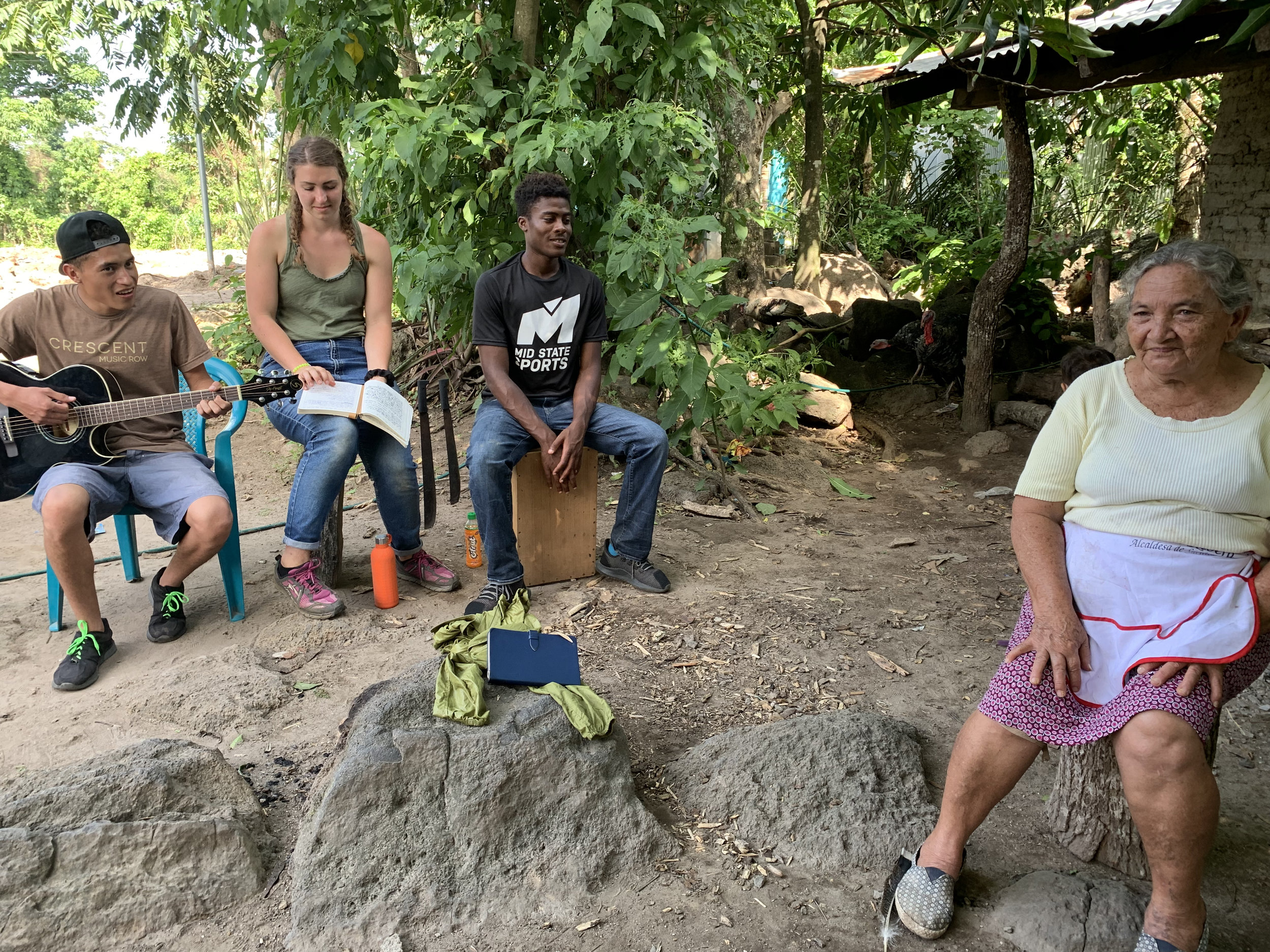 Alison and Gerron, members of Da Mission team, singing worship songs with Antonia at right.