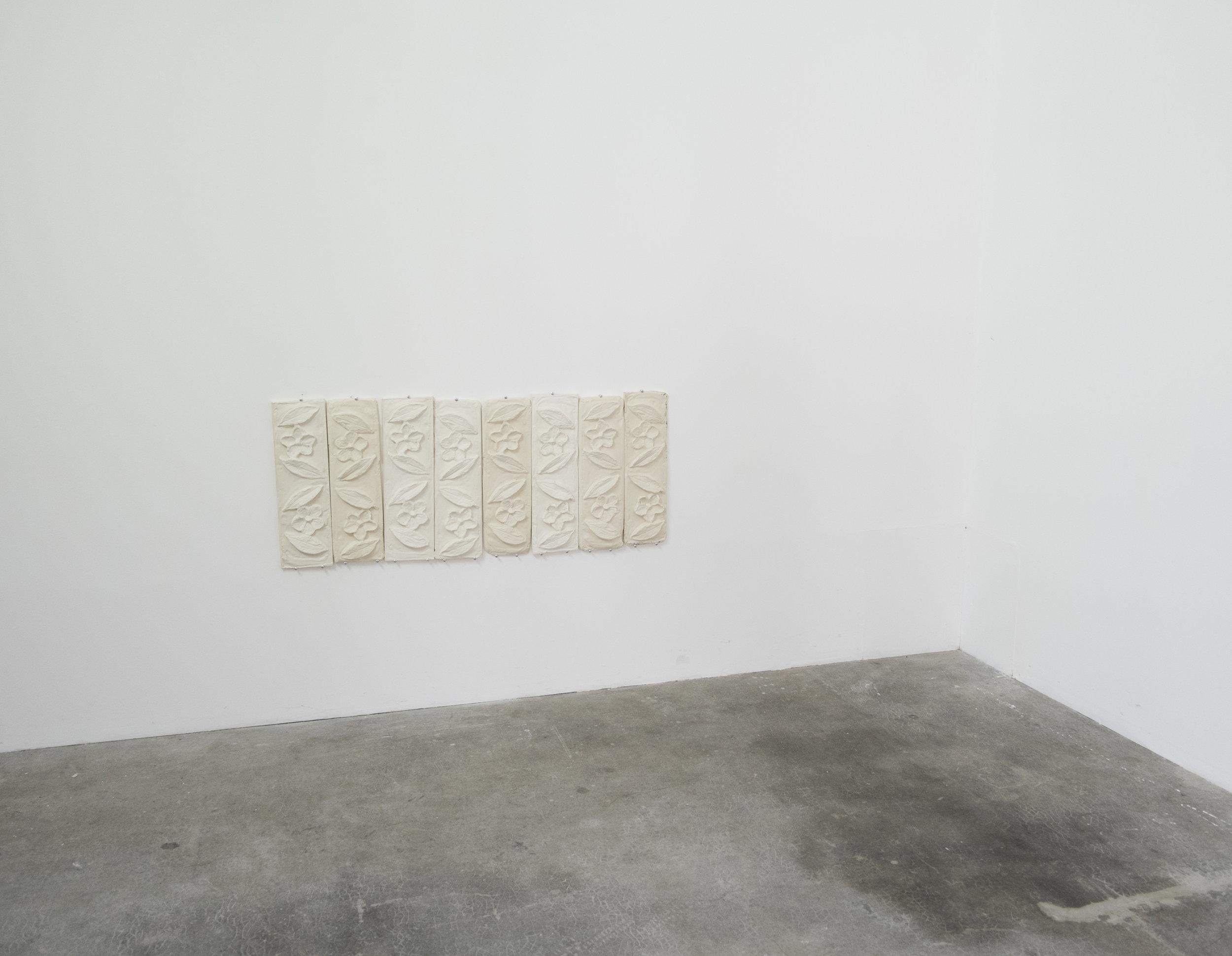 "Installation view each panel: plaster, 4"" x 15"", 2017"