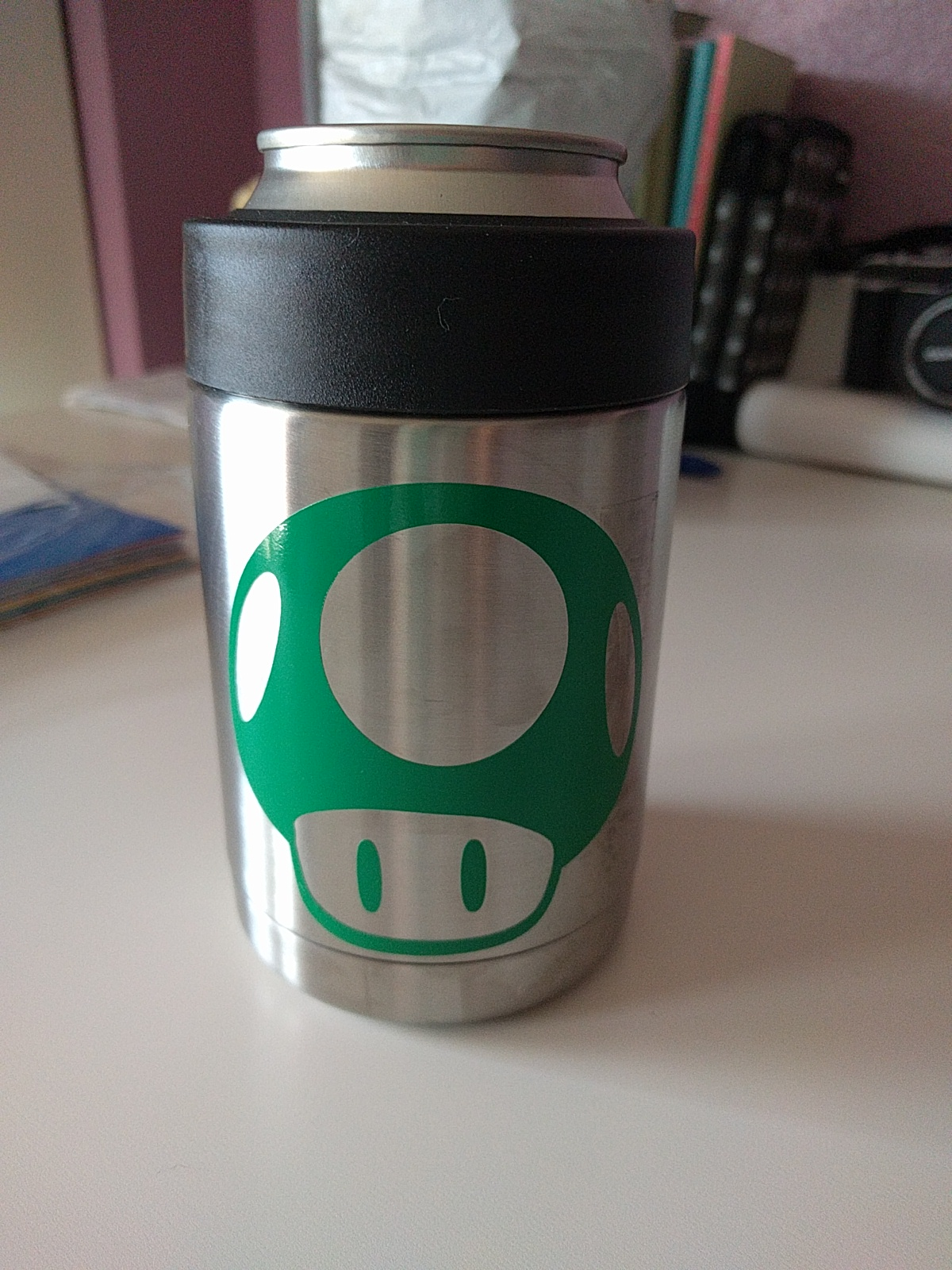 """Notes:  - I cleaned the surface with alcohol  - I used scotch tape for moving the design from the matt/backing to the surface. Perfect amount of stickiness  - etsy file -> https://www.etsy.com/listing/525736348/super-mario-dxf-super-mario-eps-mario-1?ga_search_query=mushroom&ref=shop_items_search_ 1     Materials I used:   - Official Yeti Koozie thing (the best)! YETI Rambler Vacuum Insulated Stainless Steel Colster   - This is the first time I've used this brand of vinyl (it is more permanent than crictu brand) and it was great! Ultimate Oracal 651 Starter Pack 63 Glossy Self Adhesive Vinyl Sheets (12"""" x 12"""", 63 Assortment)     Links:  - I used this tutorial as a starting point: http://www.leapoffaithcrafting.com/applying-vinyl-to-a-tumbler/"""