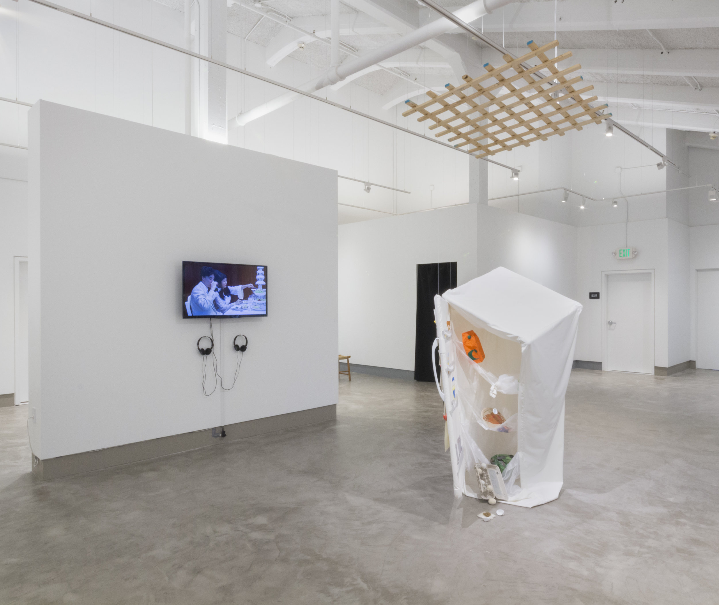 """""""Purging"""" (Exhibition view at Embark Gallery, San Francisco, CA), 2016, Screen-printed fabric, cardboard, milk jug, clay, felted wool, ink thread, pvc, monofilament, fridge light, Dimensions variable"""