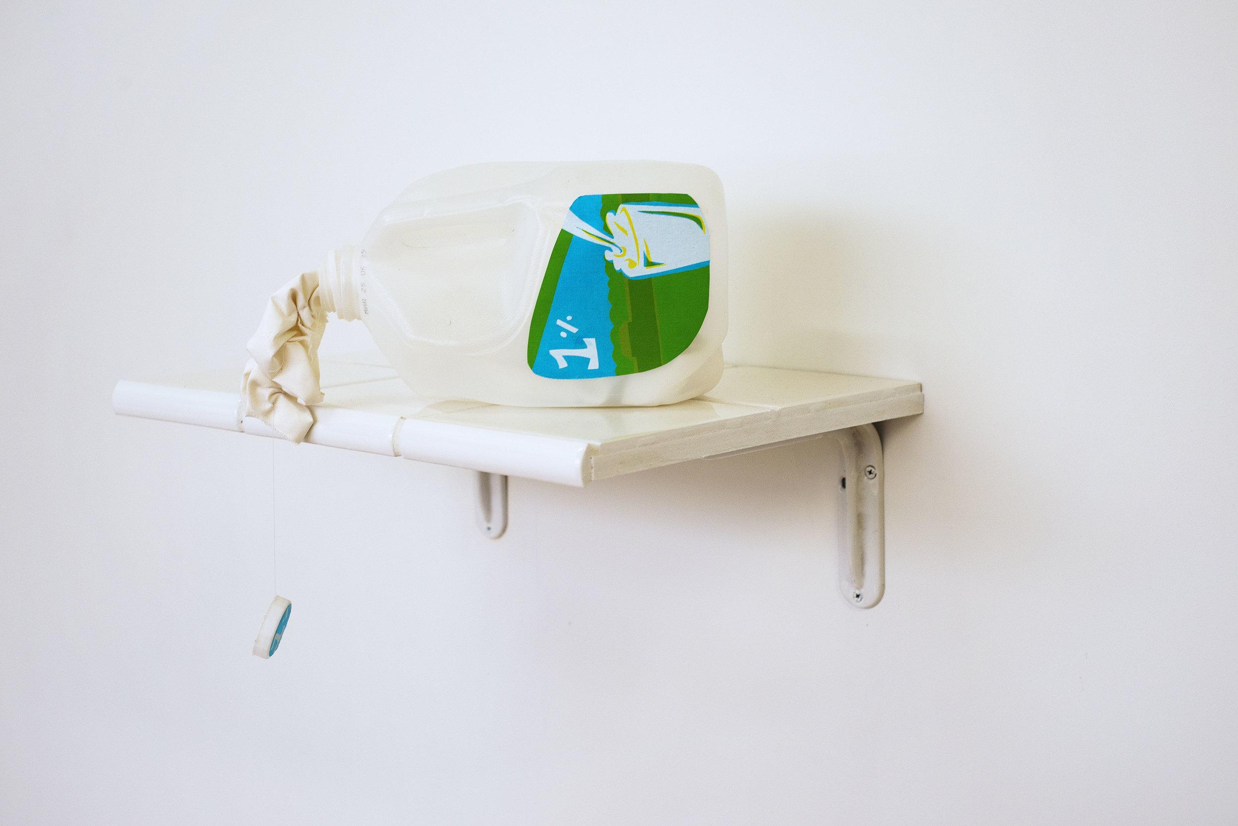 """Splittin'"", 2016, Screen-printed fabric, 1-gal milk jug, blackout fabric, tile, grout, MDF"