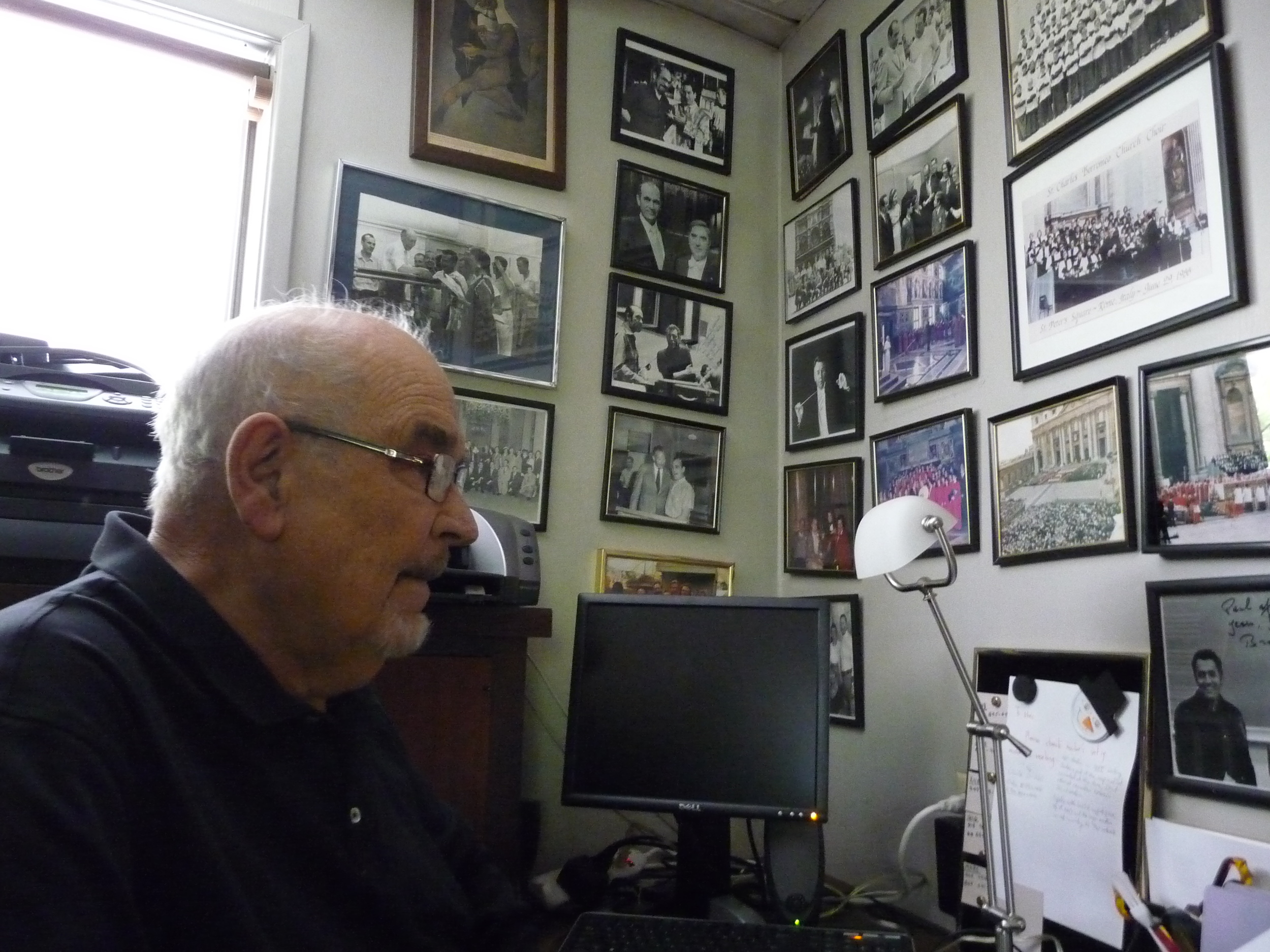 Conductor Paul Salamunovich in his home office (his copy of a portrait of him and Durufle hangs behind him, Durufle's copy still hangs in the former Durufle residence in France).