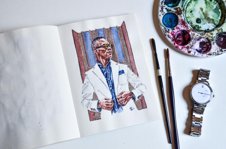 Sabir Peele portrait in sketchbook set in a flat lay