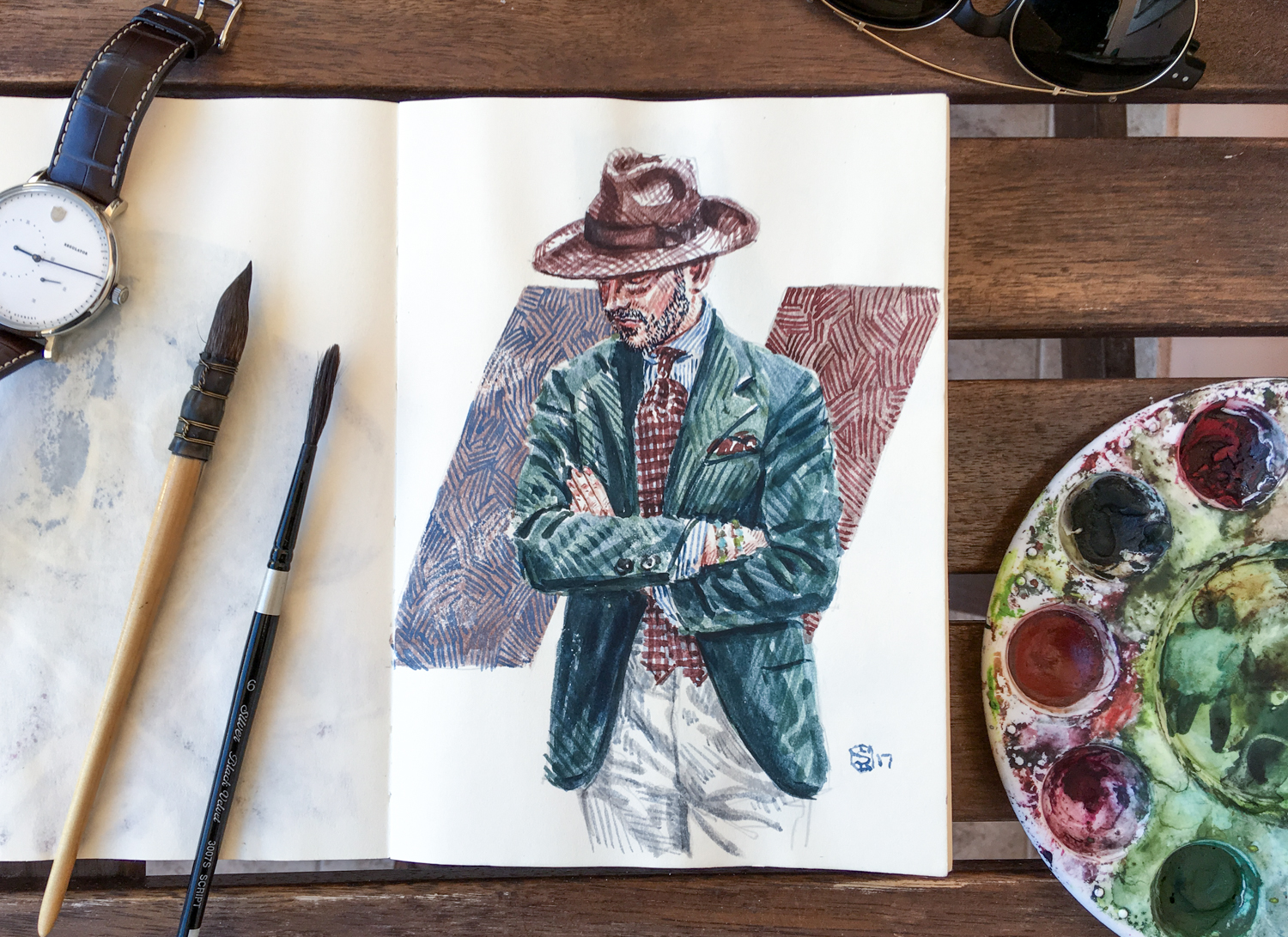 Sketchbook open to page with men's fashion illustration of Benedikt Fries, founder of Shibumi Firenze.