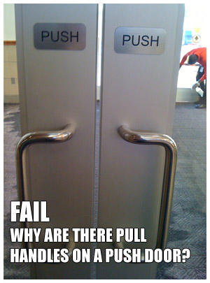 a pair of PUSH doors with PULL handles